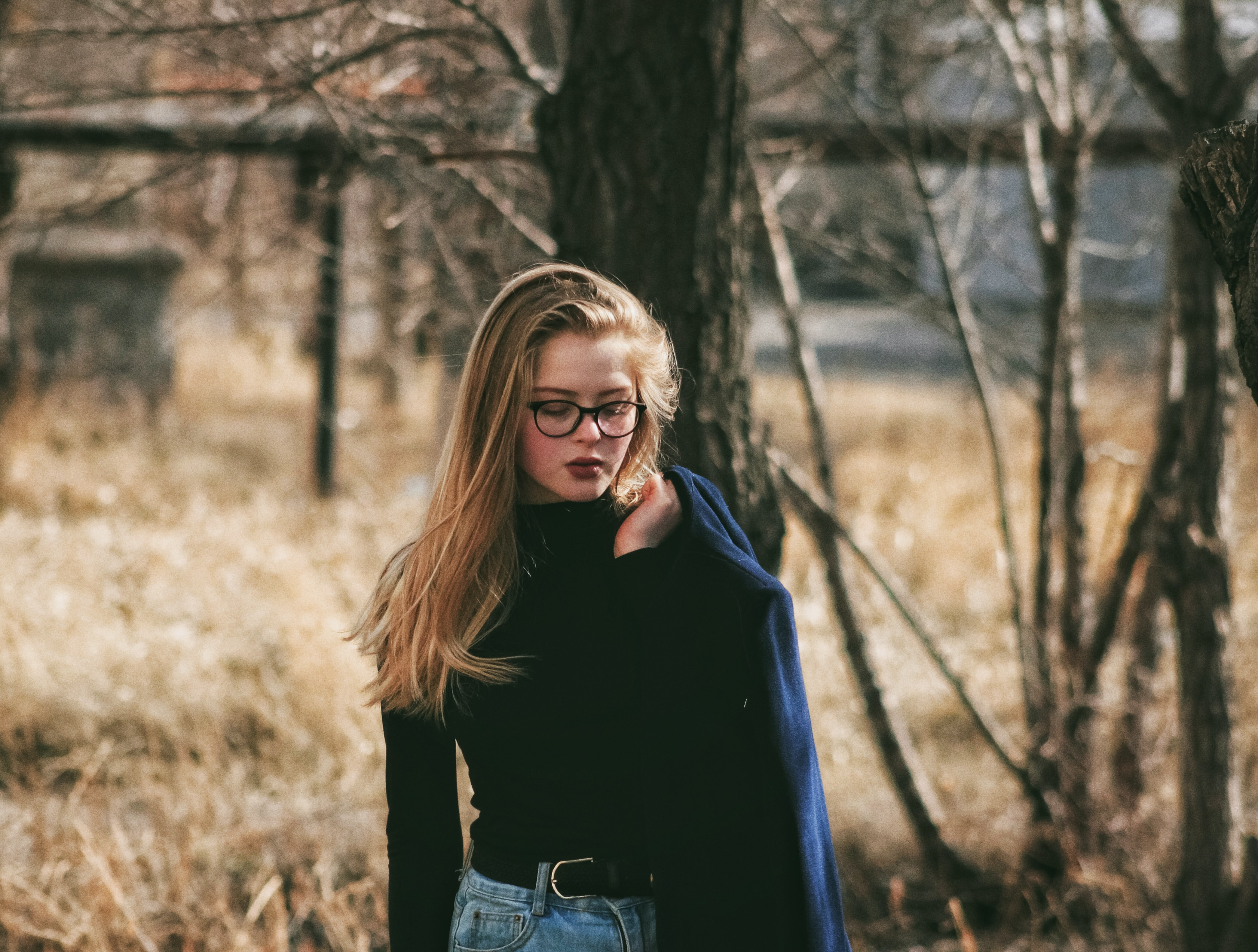 woman wearing black sweater holding her coat