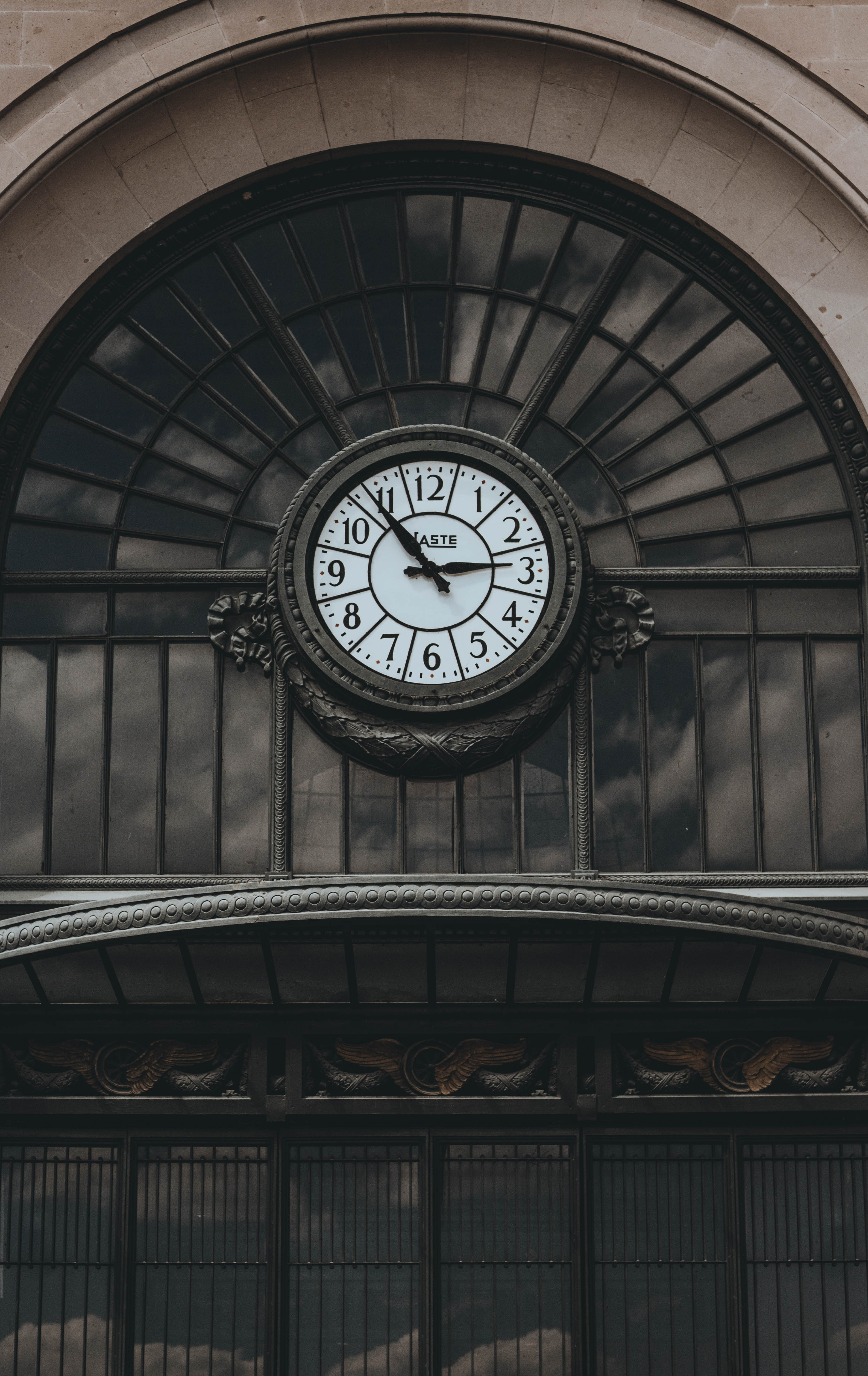 round brown analog clock in building