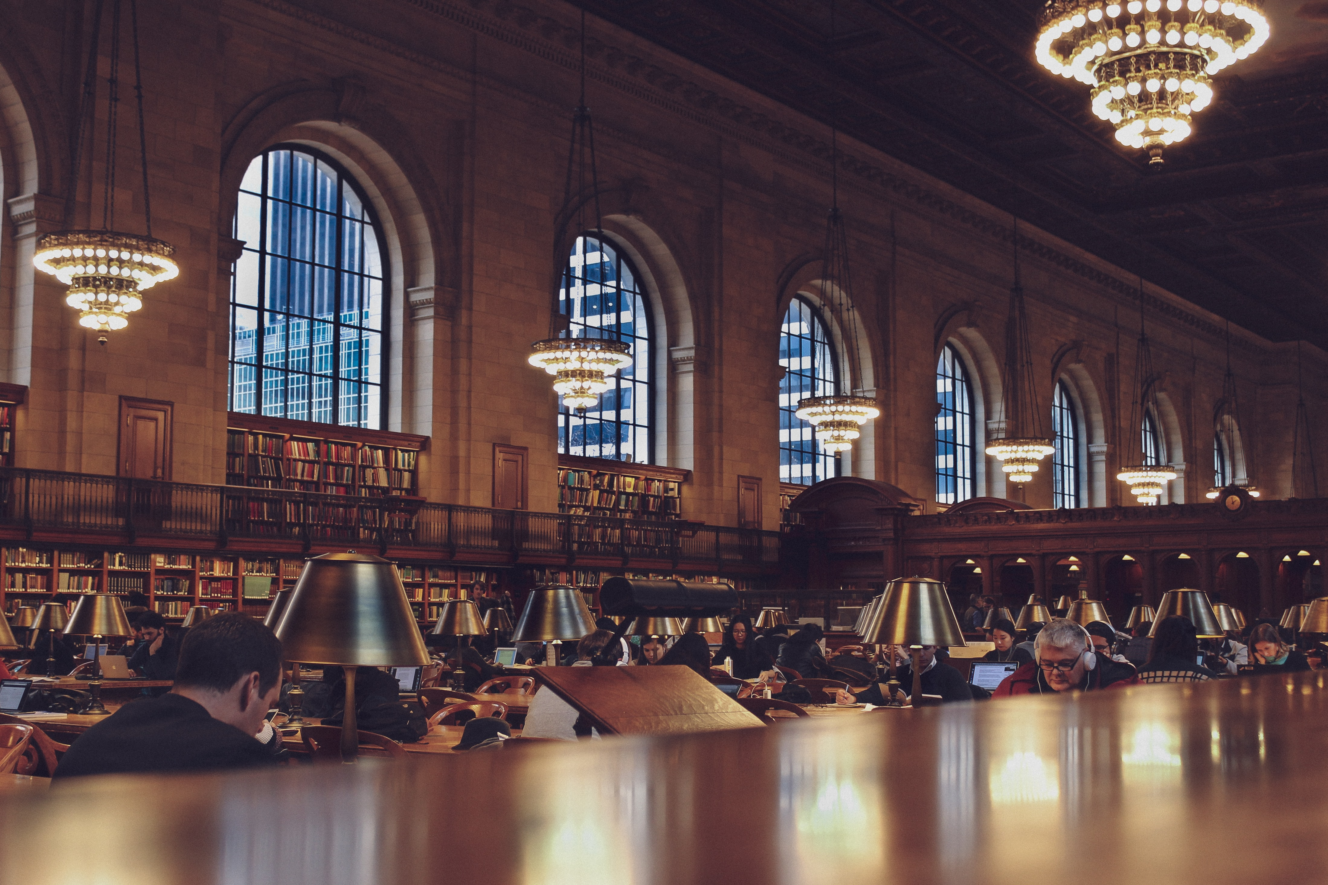 people reading inside library building