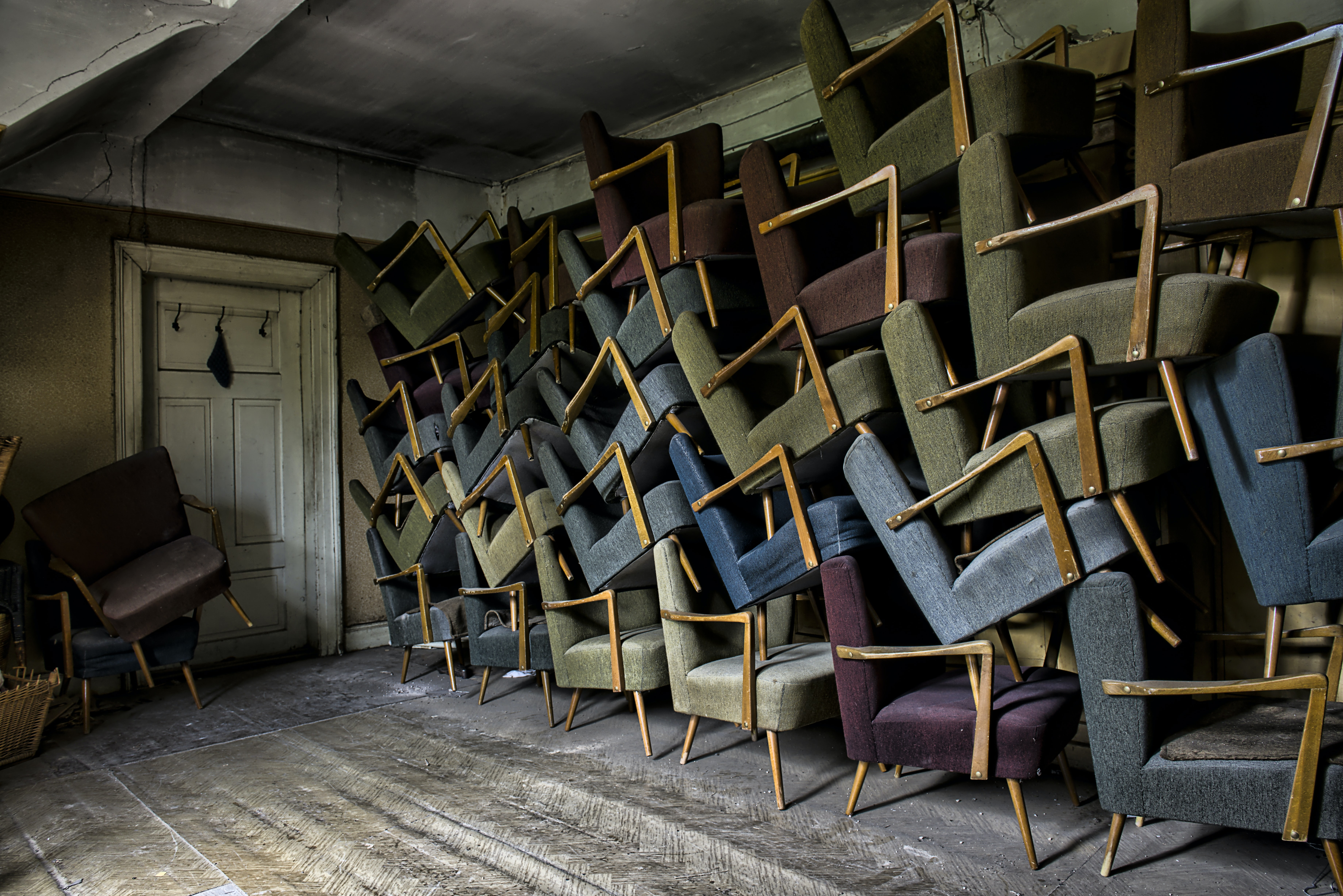 assorted armchair on wall near door