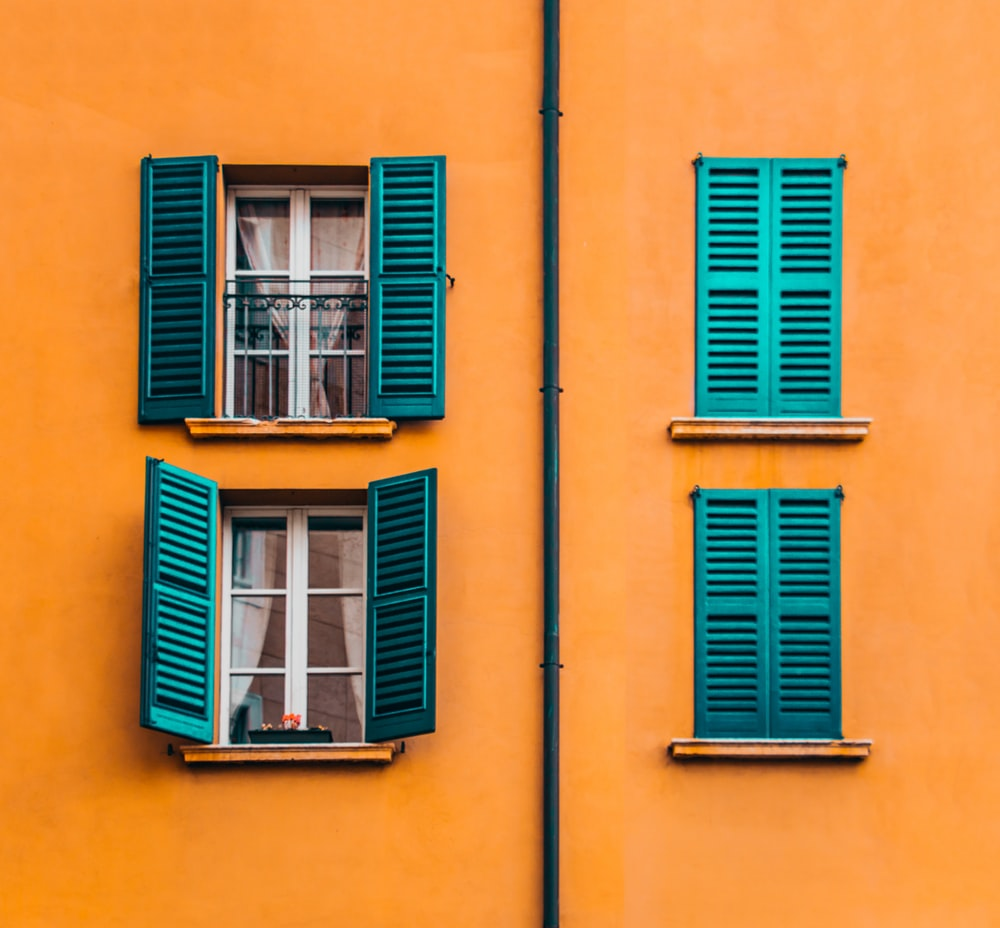 orange and green painted building