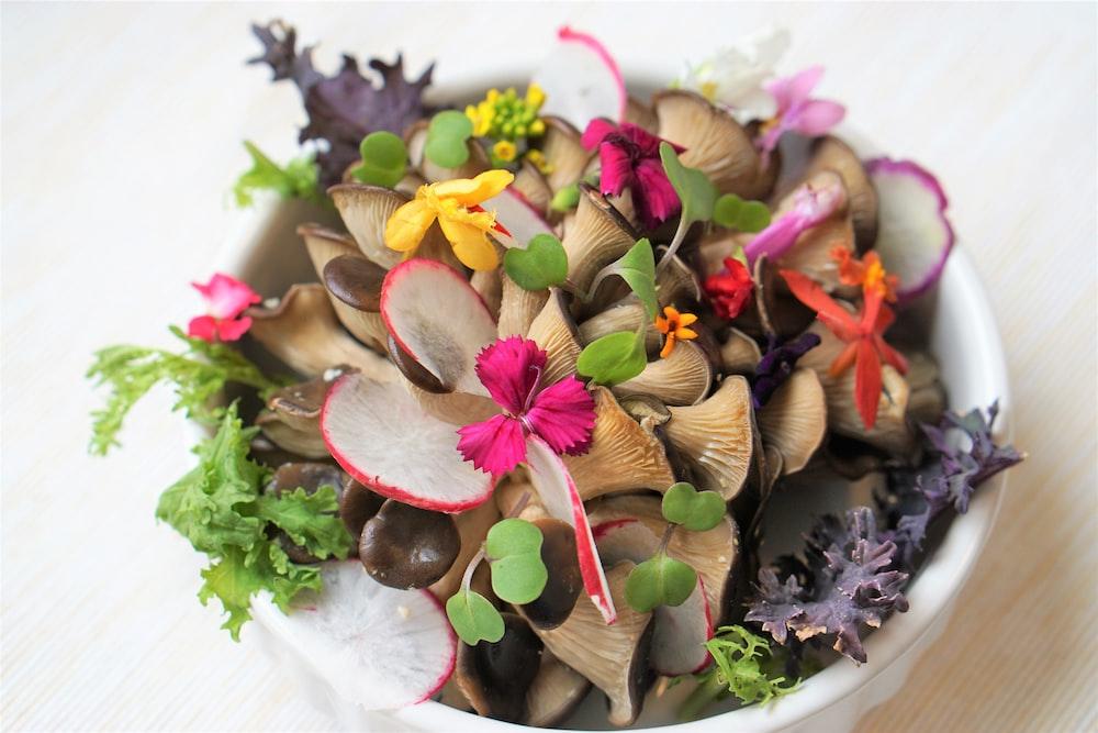 brown mushrooms on white bowl
