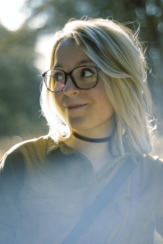 woman wearing eyeglasses with black sling bag