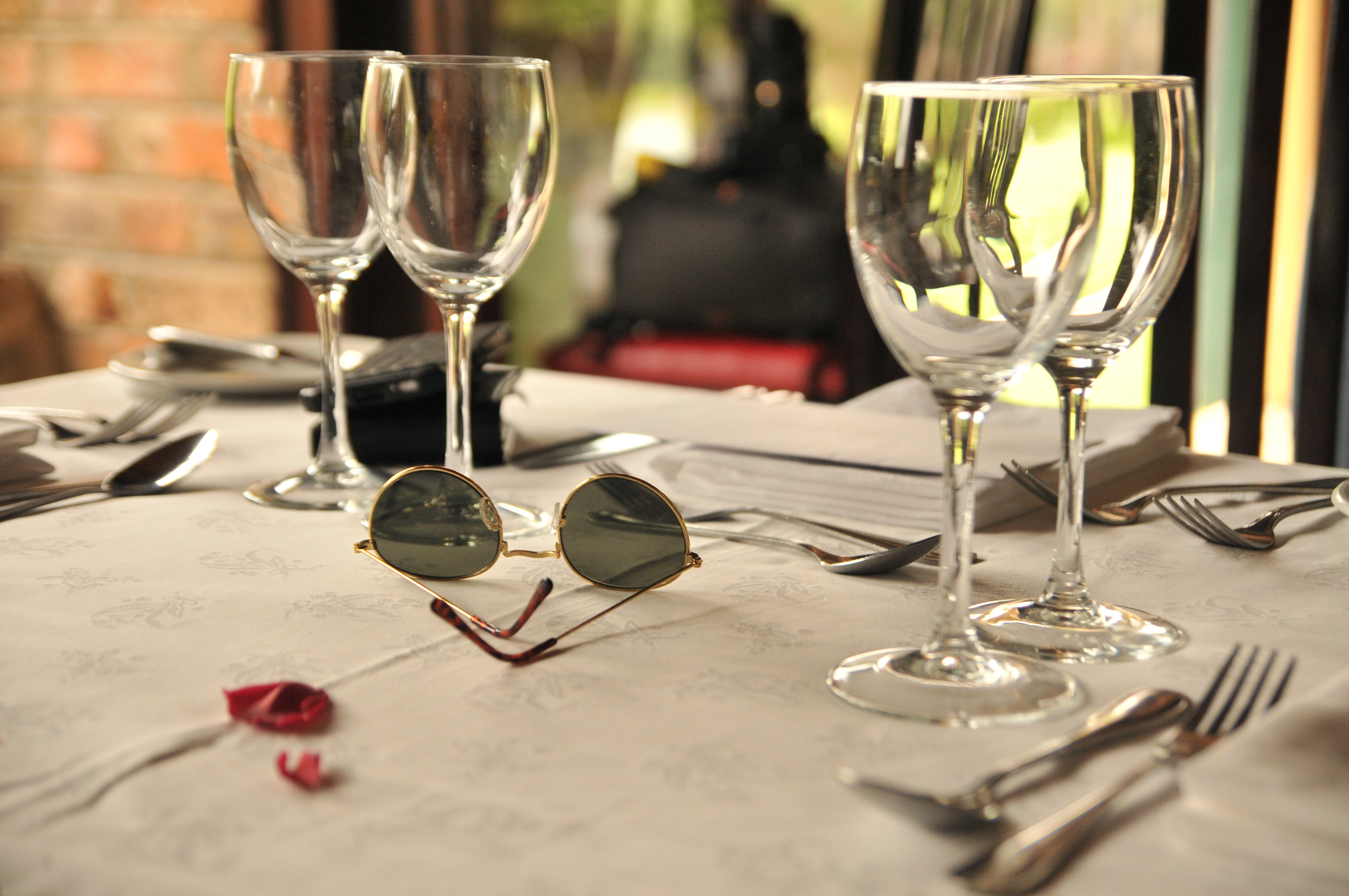 selective focus photography of clear long-stem wine glasses on table