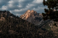 brown mountain under cloudy sky
