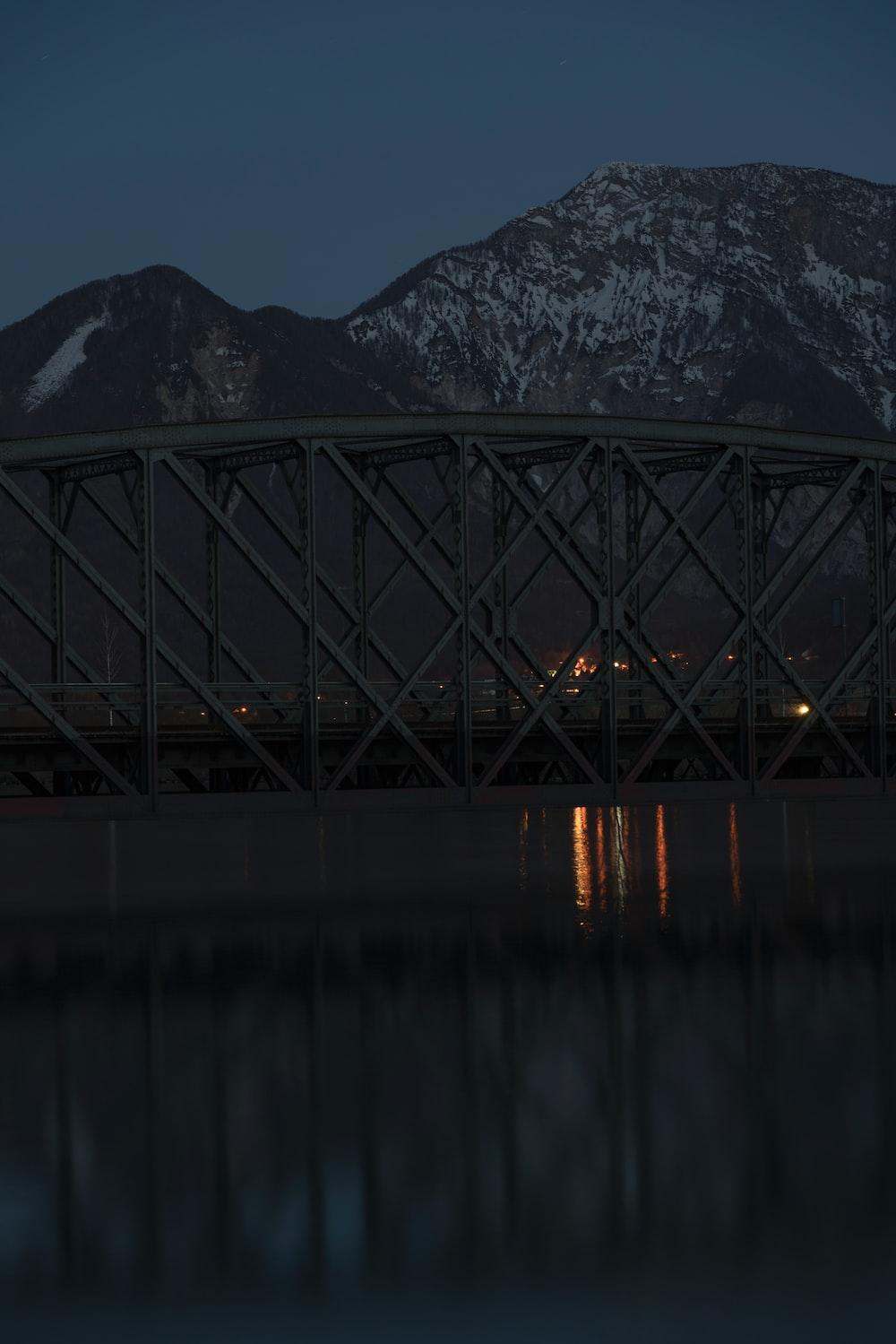 bridge beside mountain with snow