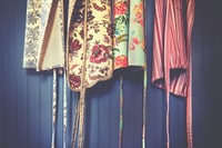 four assorted-color aprons