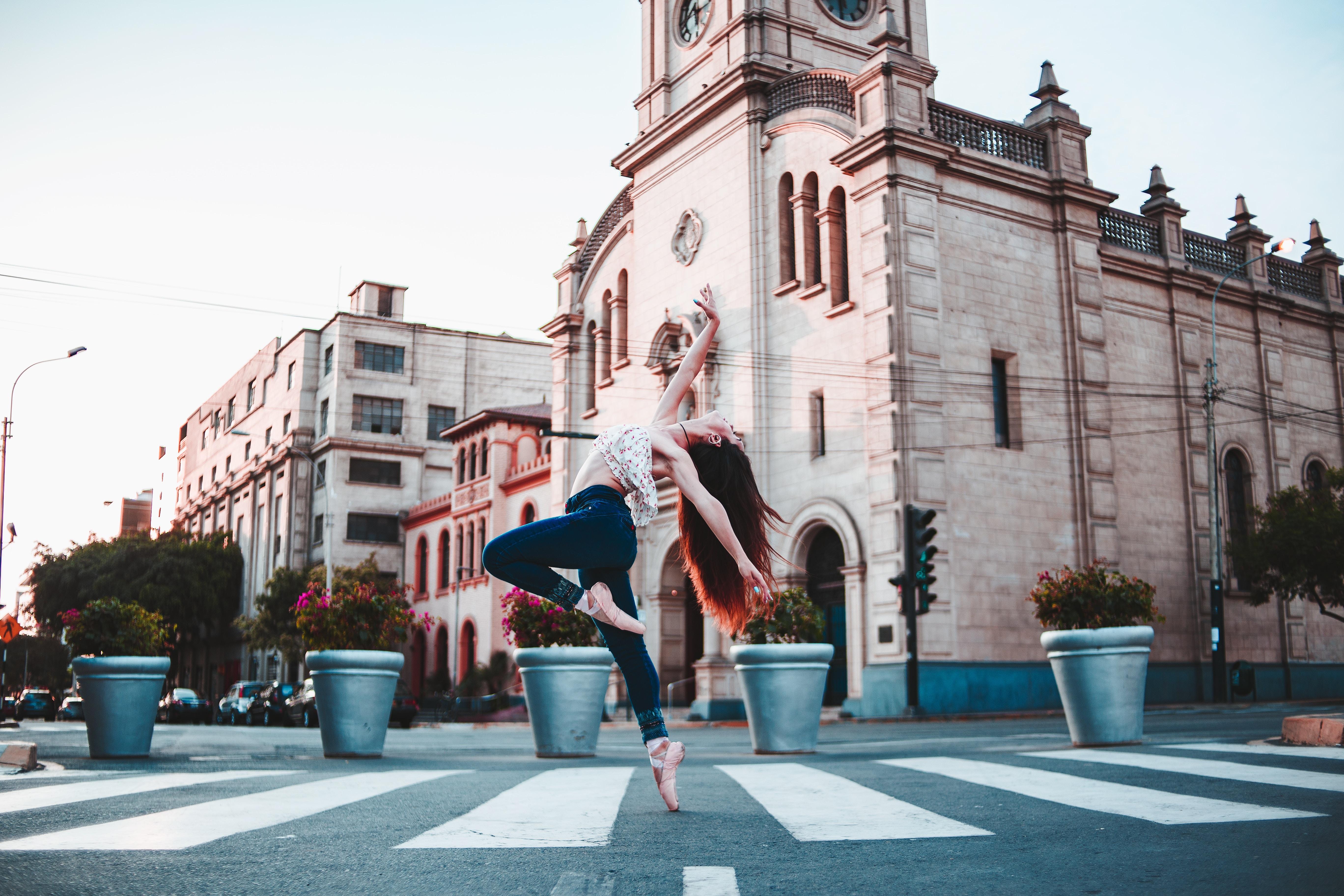 woman dancing on street