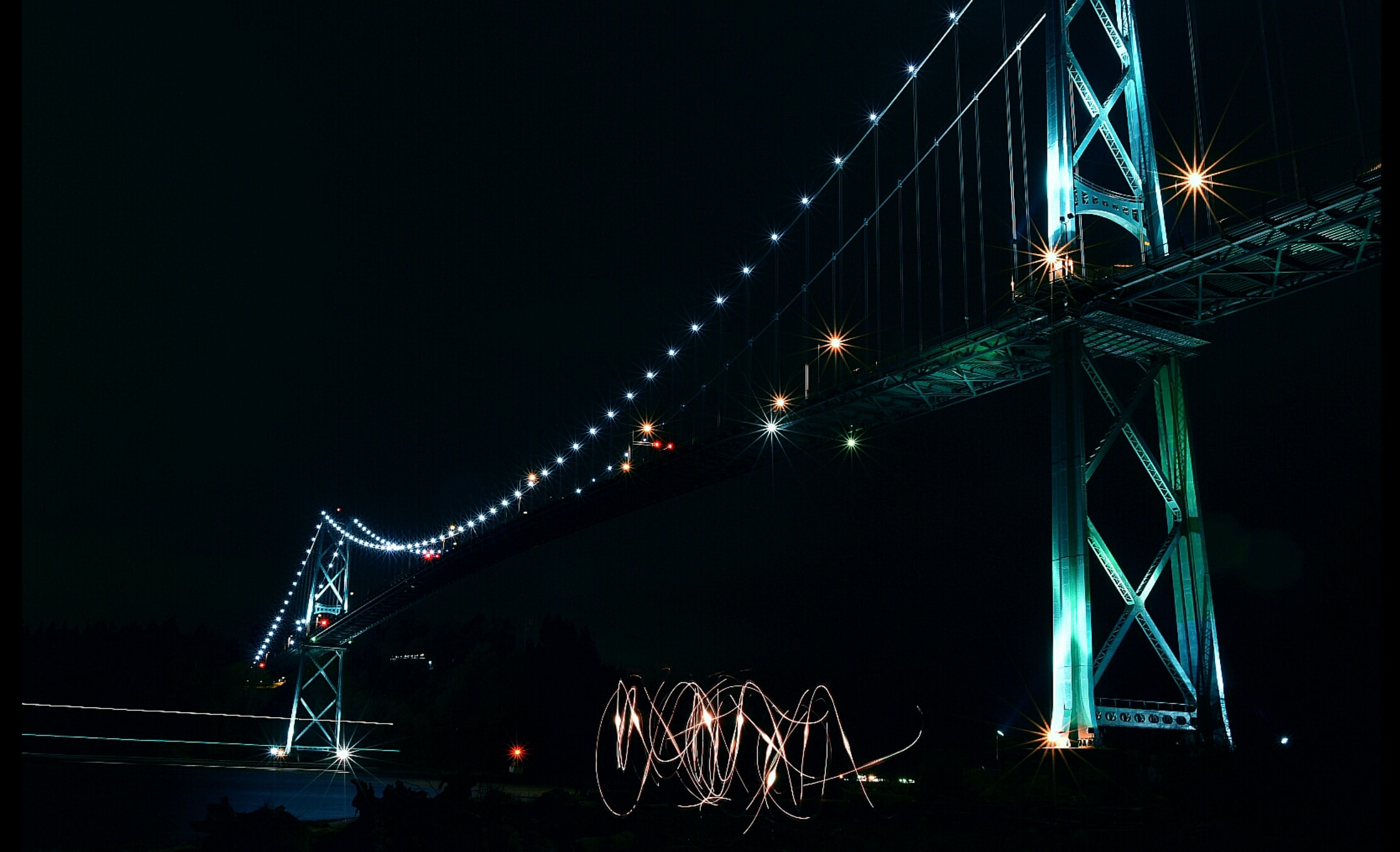 low angle photography of lighted cable bridge