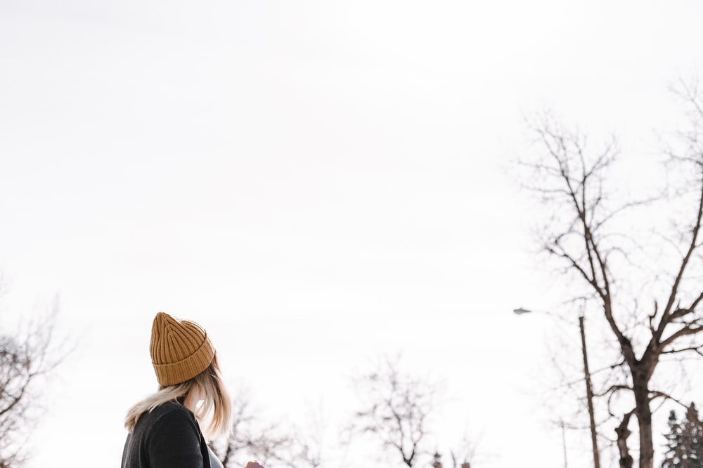 woman wearing brown beanie during daytime