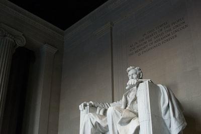 white concrete statue lincoln memorial teams background