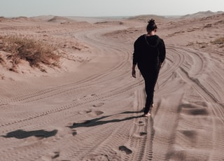 woman walking on the desert