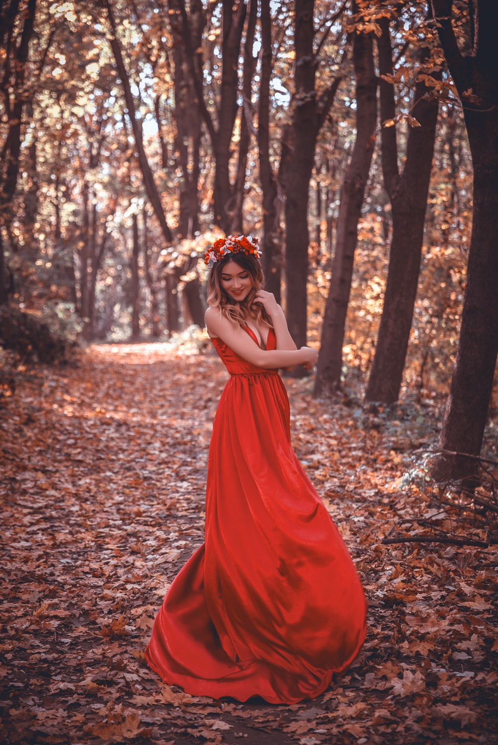 woman in red dress surrounded by trees