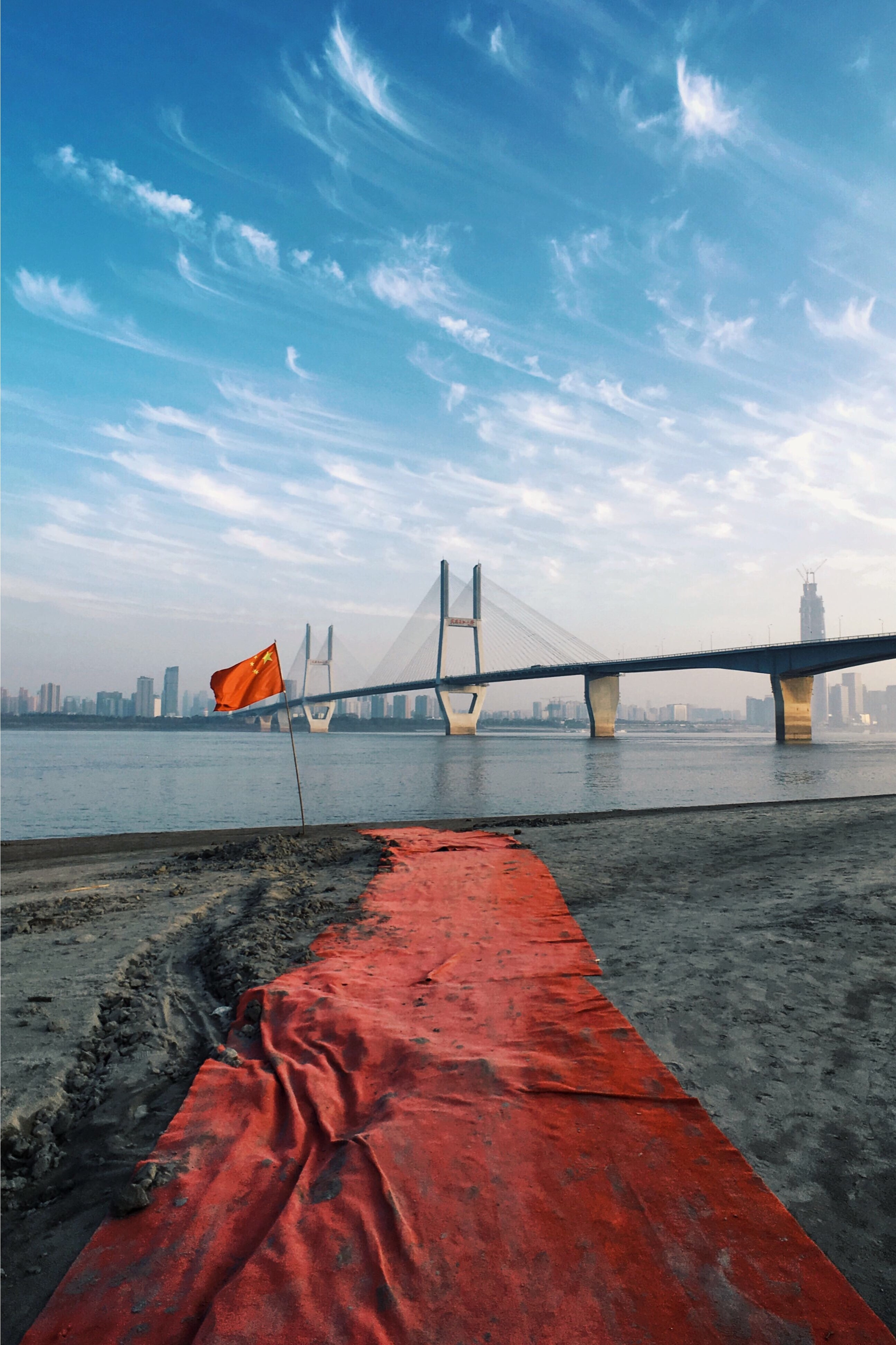 China flag near body of water during daytime