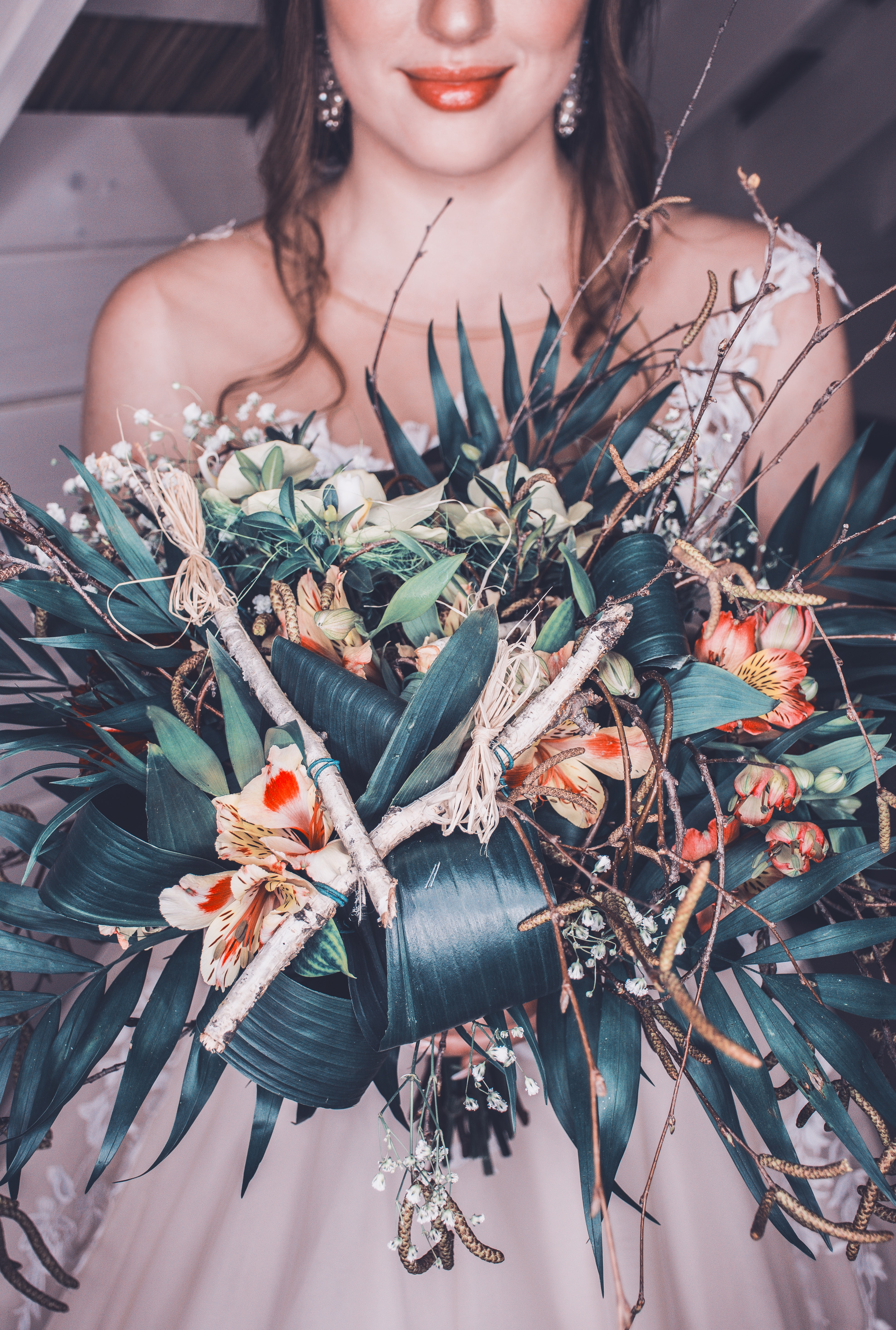 selective focus photography of woman holding flower bouquet