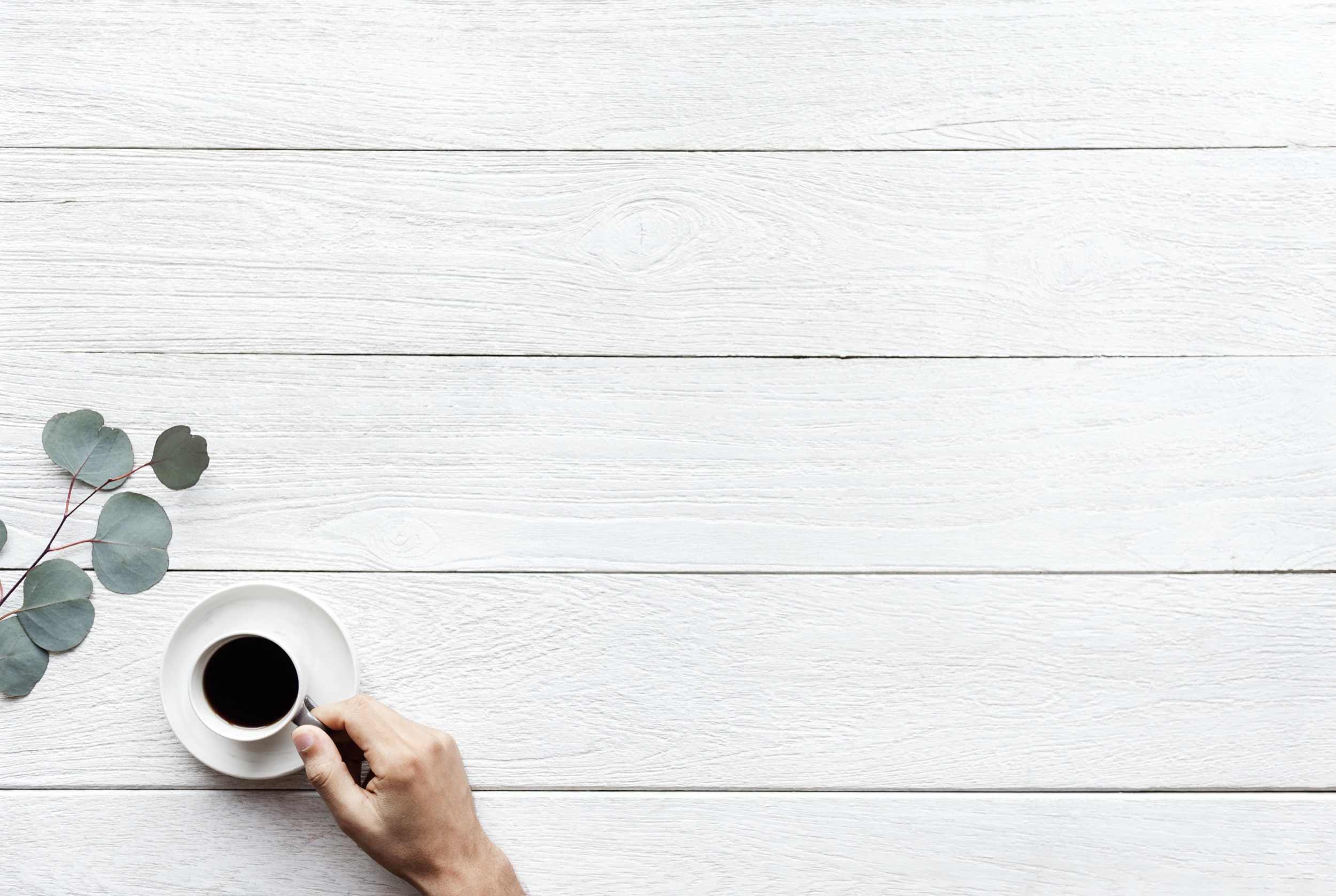 person holding white cup filled with coffee