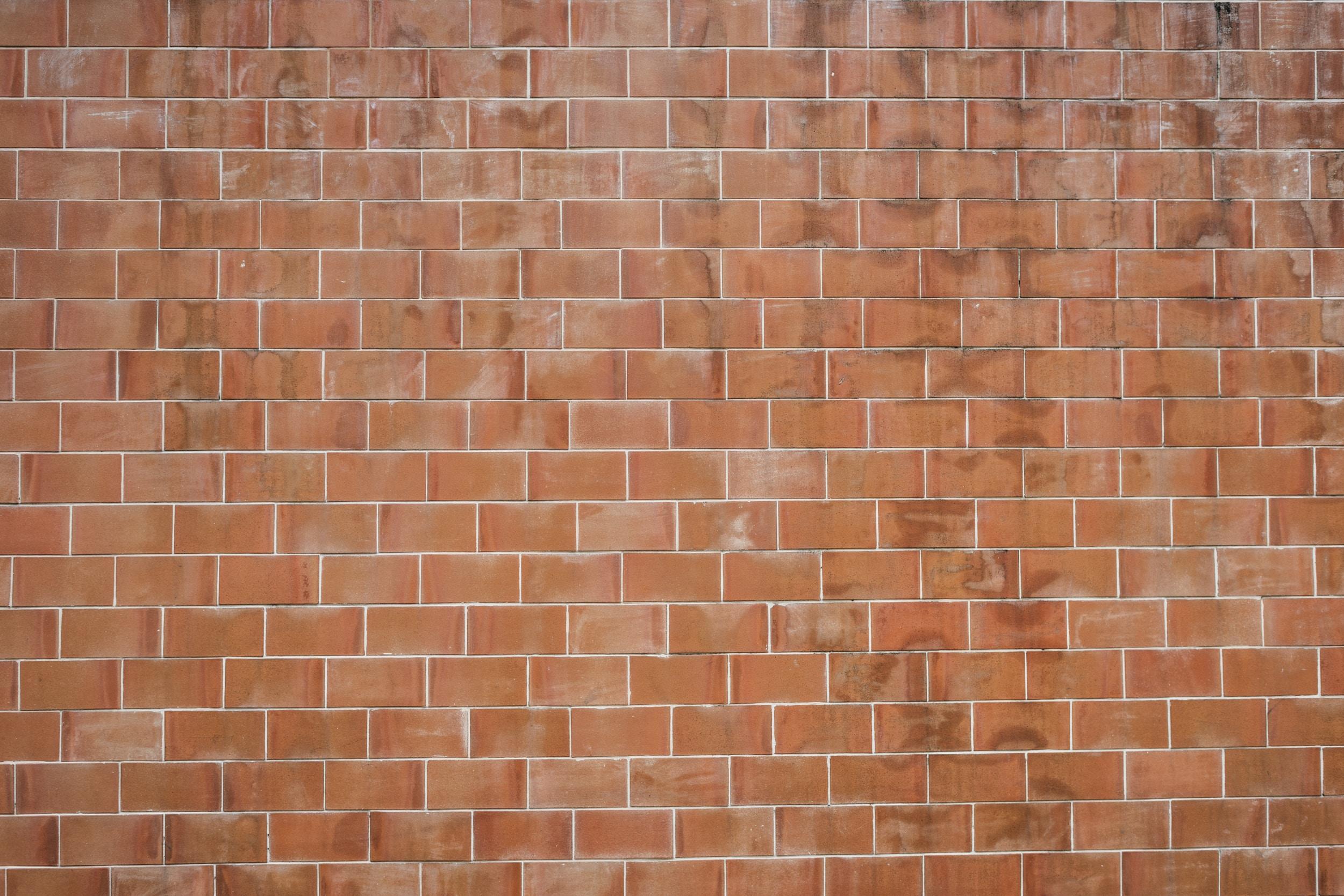 photo of brown brick wall