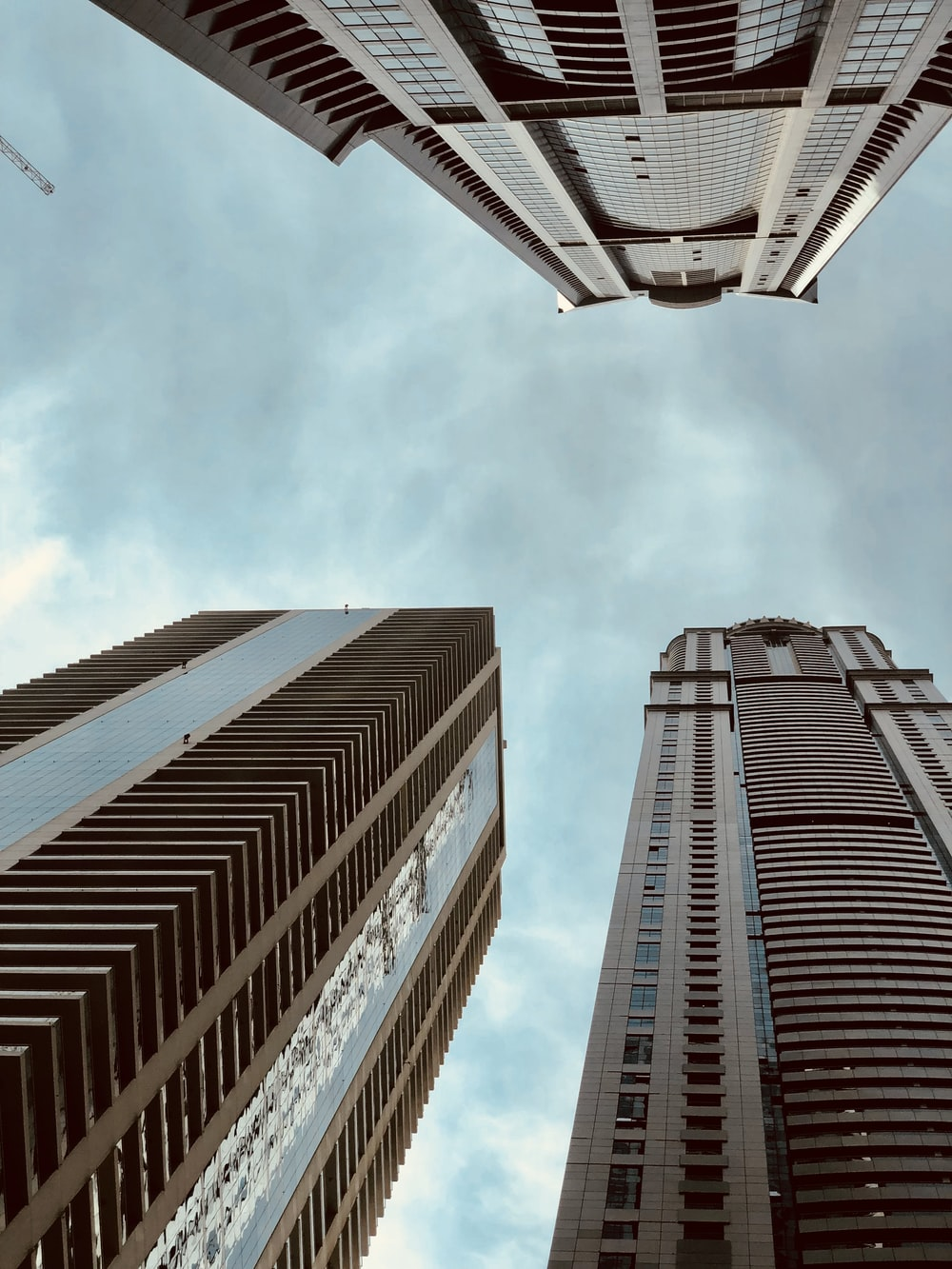 worm's eye view photography of high rise buildings