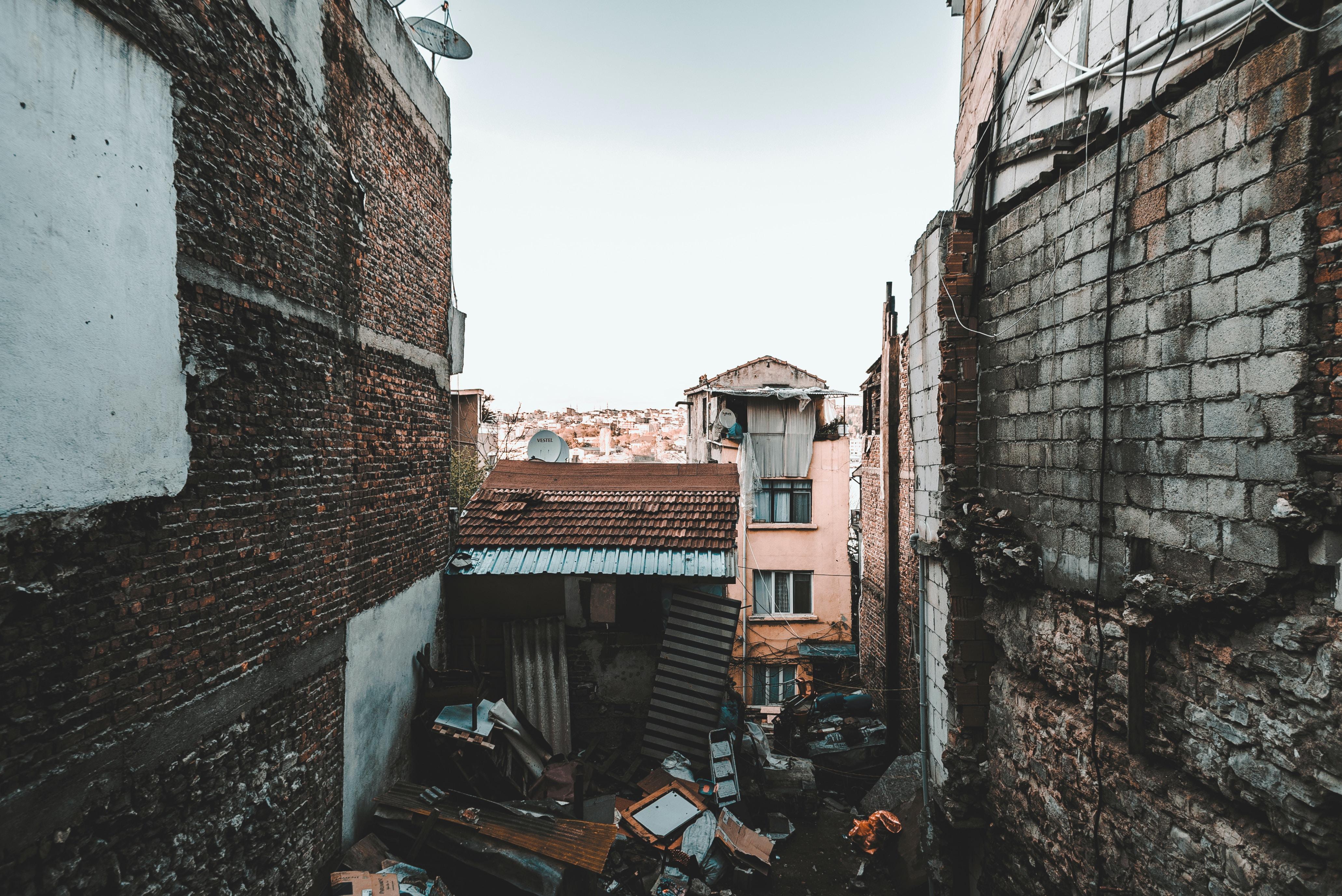 brown shed between buildings
