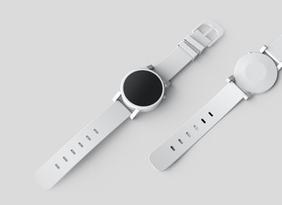 round white watch with white band product zoom background