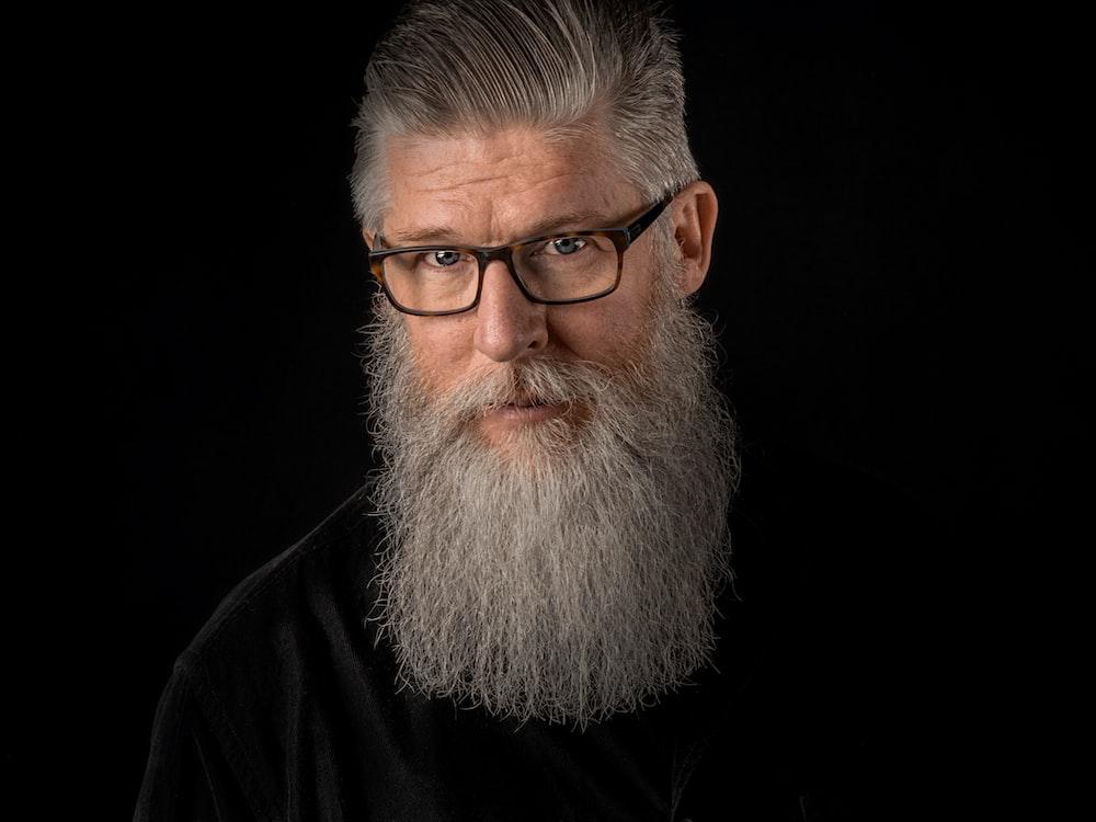 man wearing eyeglasses with black frames