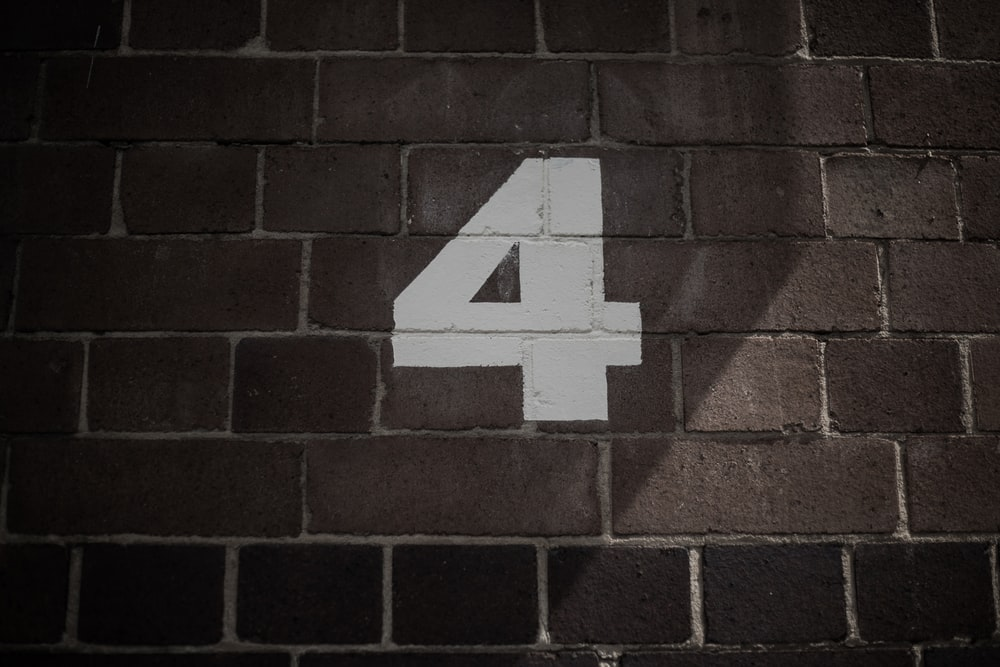 number 4 painting on wall