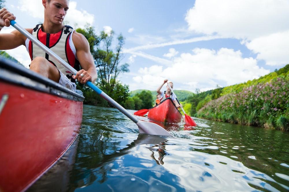photo of man and woman on kayak paddlings