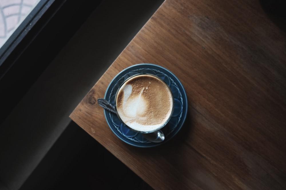 brown liquid on blue ceramic teacup