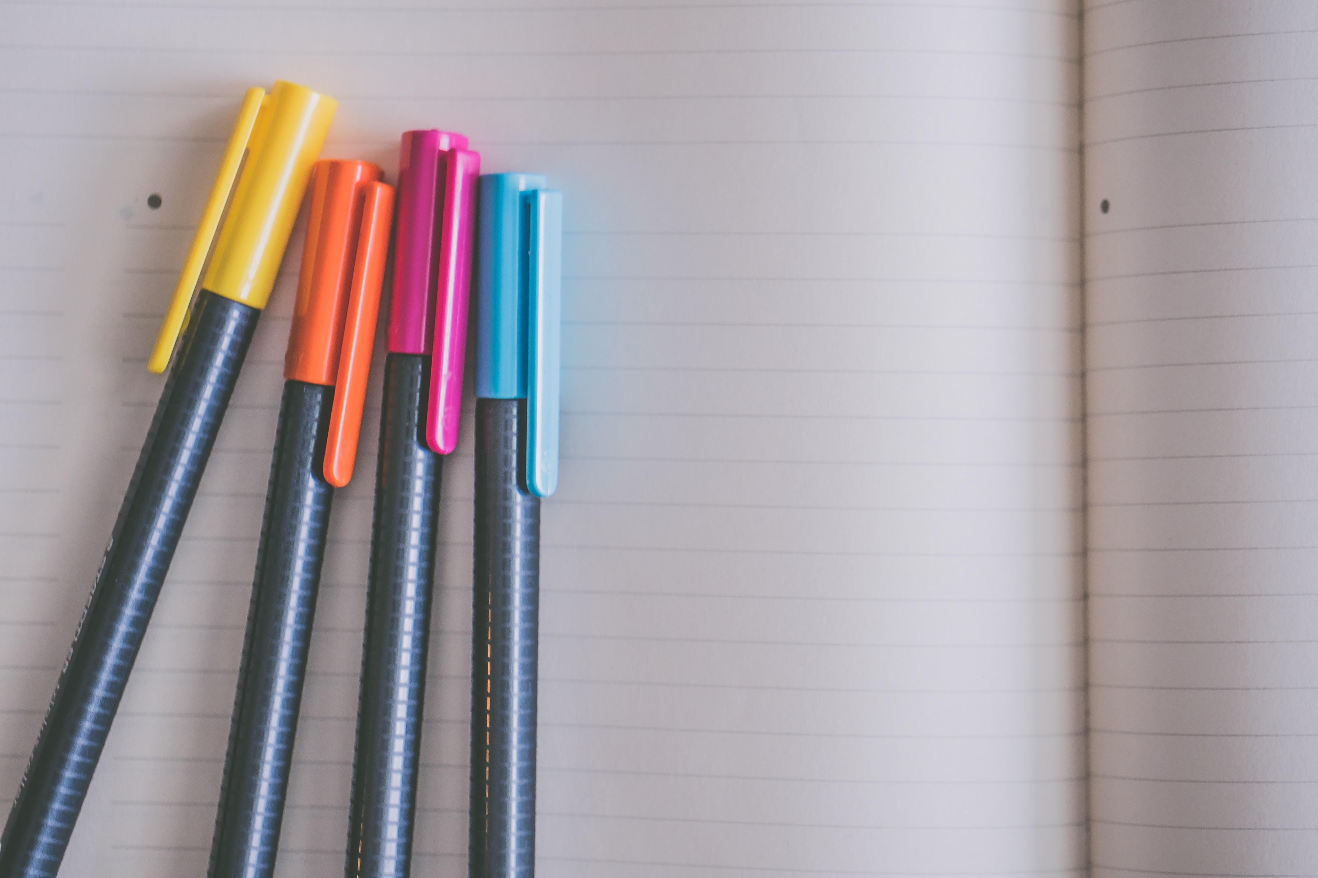 four pens on line paper