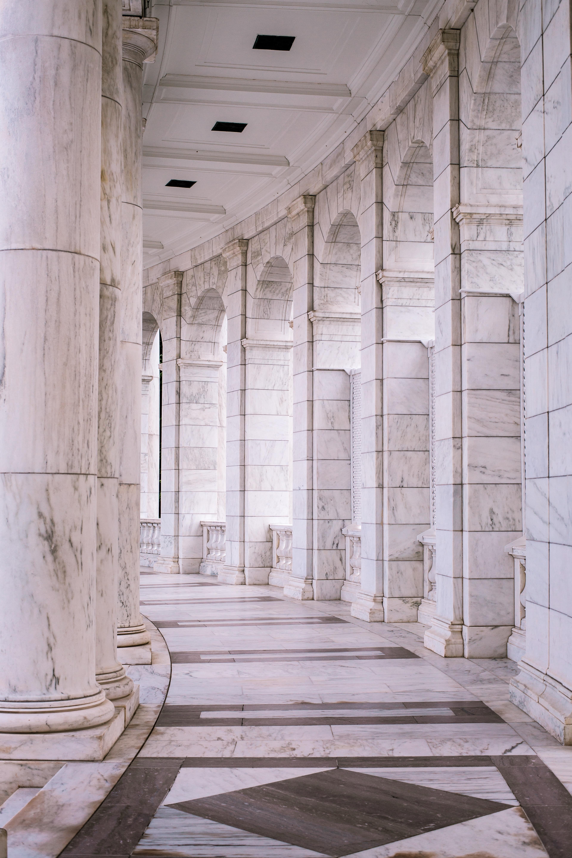 white concrete building hallway