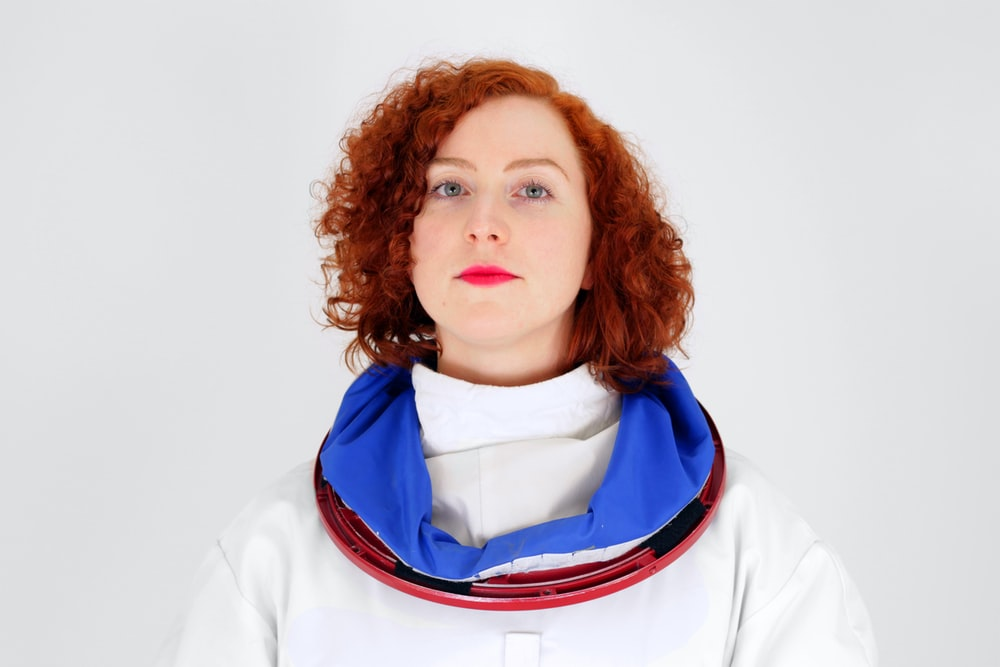 woman standing in white surface