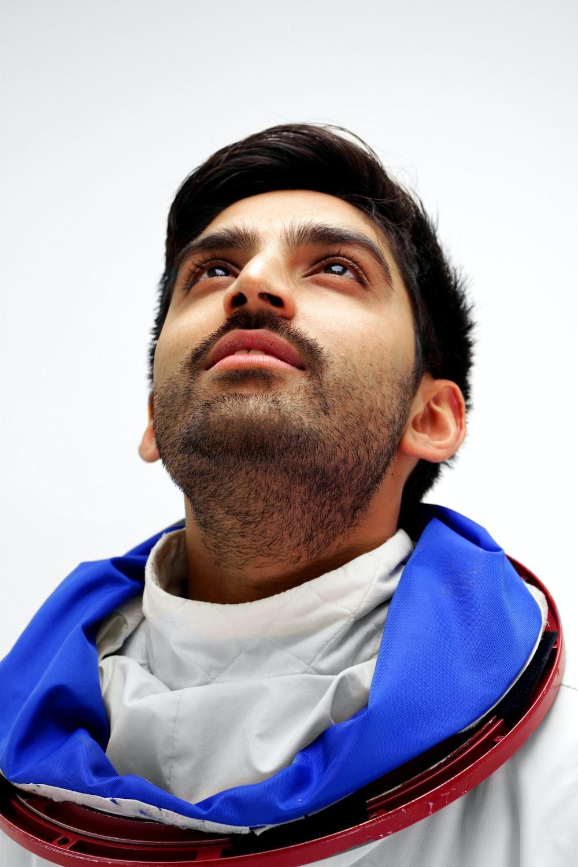 man looking up closeup photography