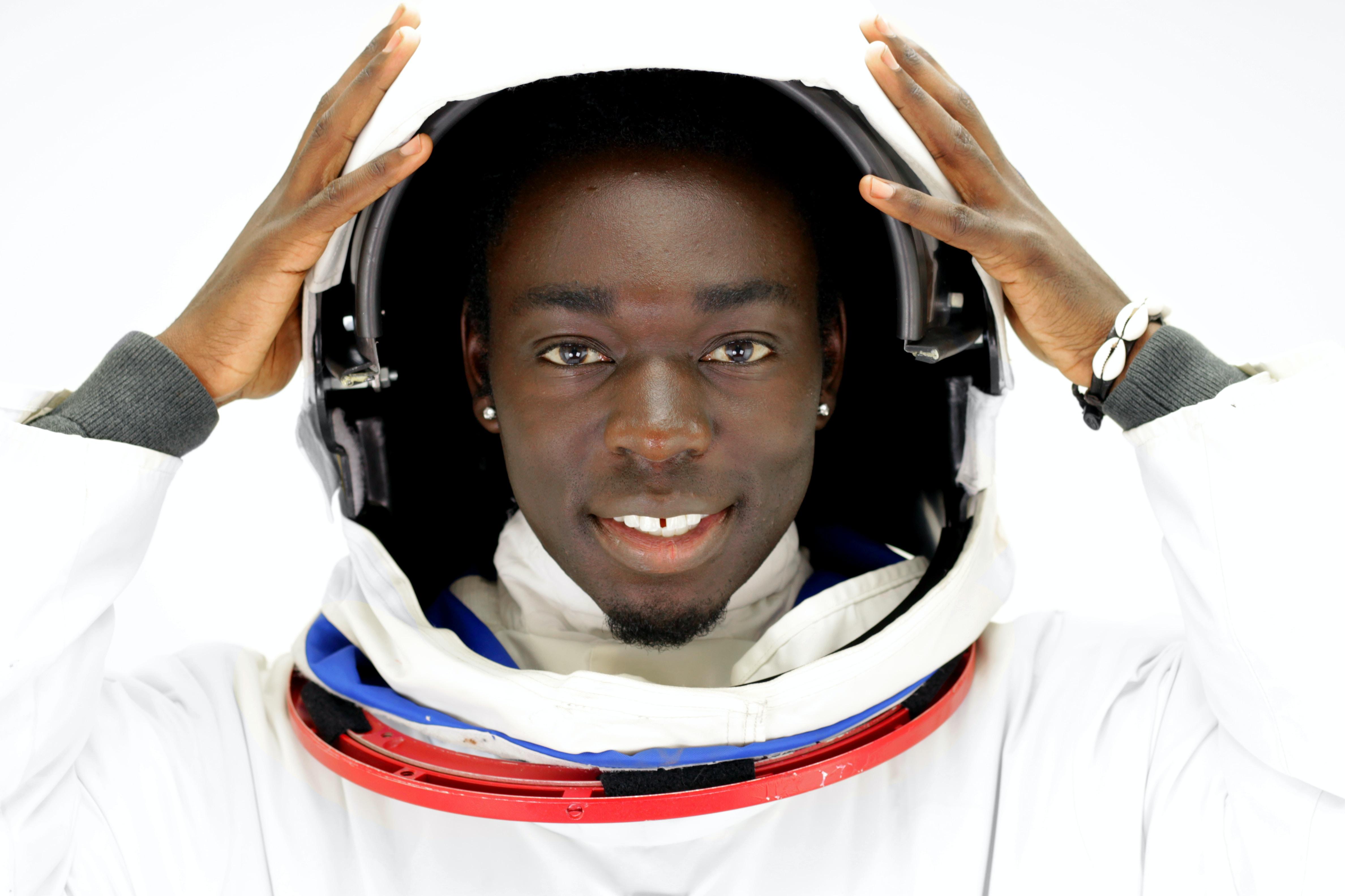 man wearing white suit
