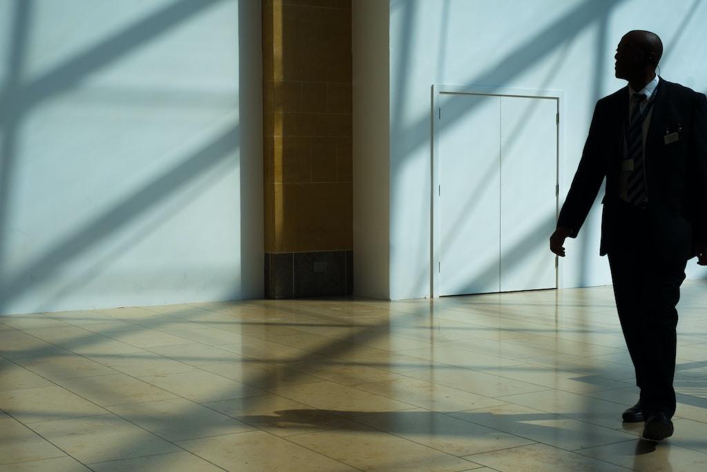 Security guard walking on hallway