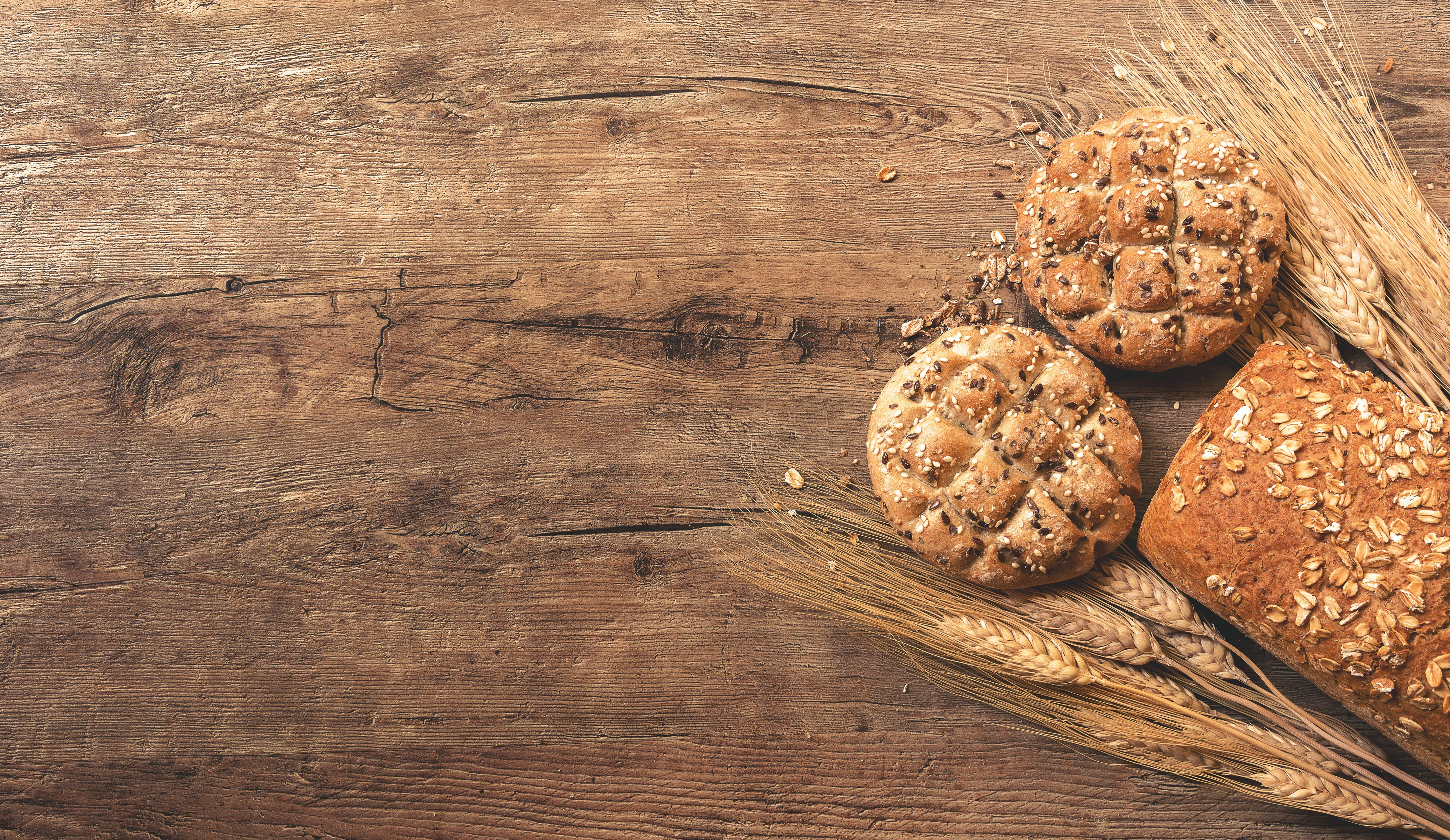 cookies, bread, and wheat on table