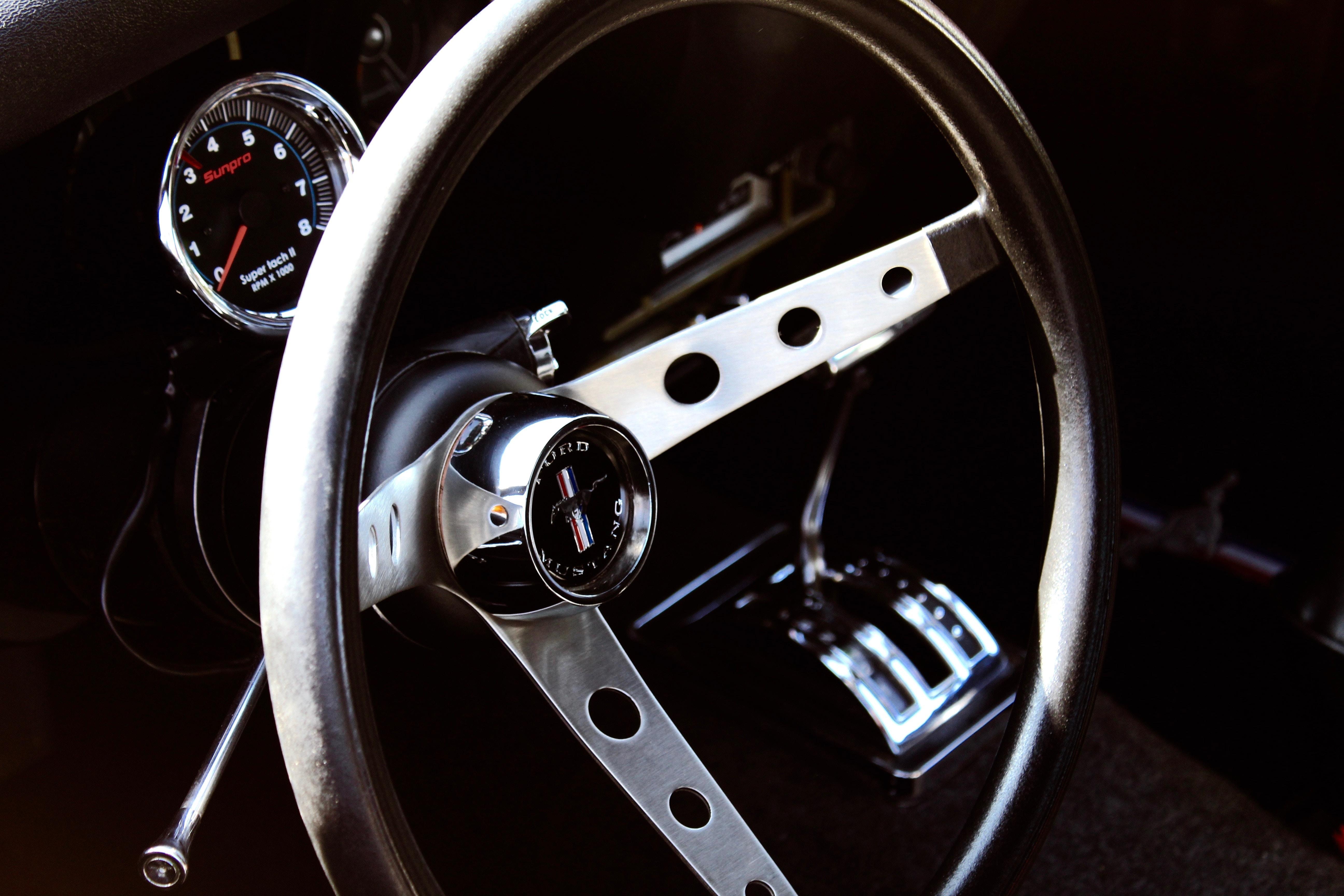 closeup photography of vehicle steering wheel