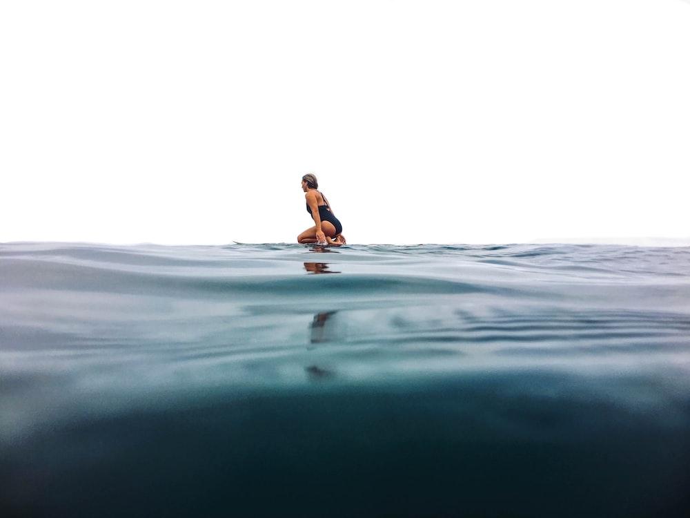 woman surfing on sea
