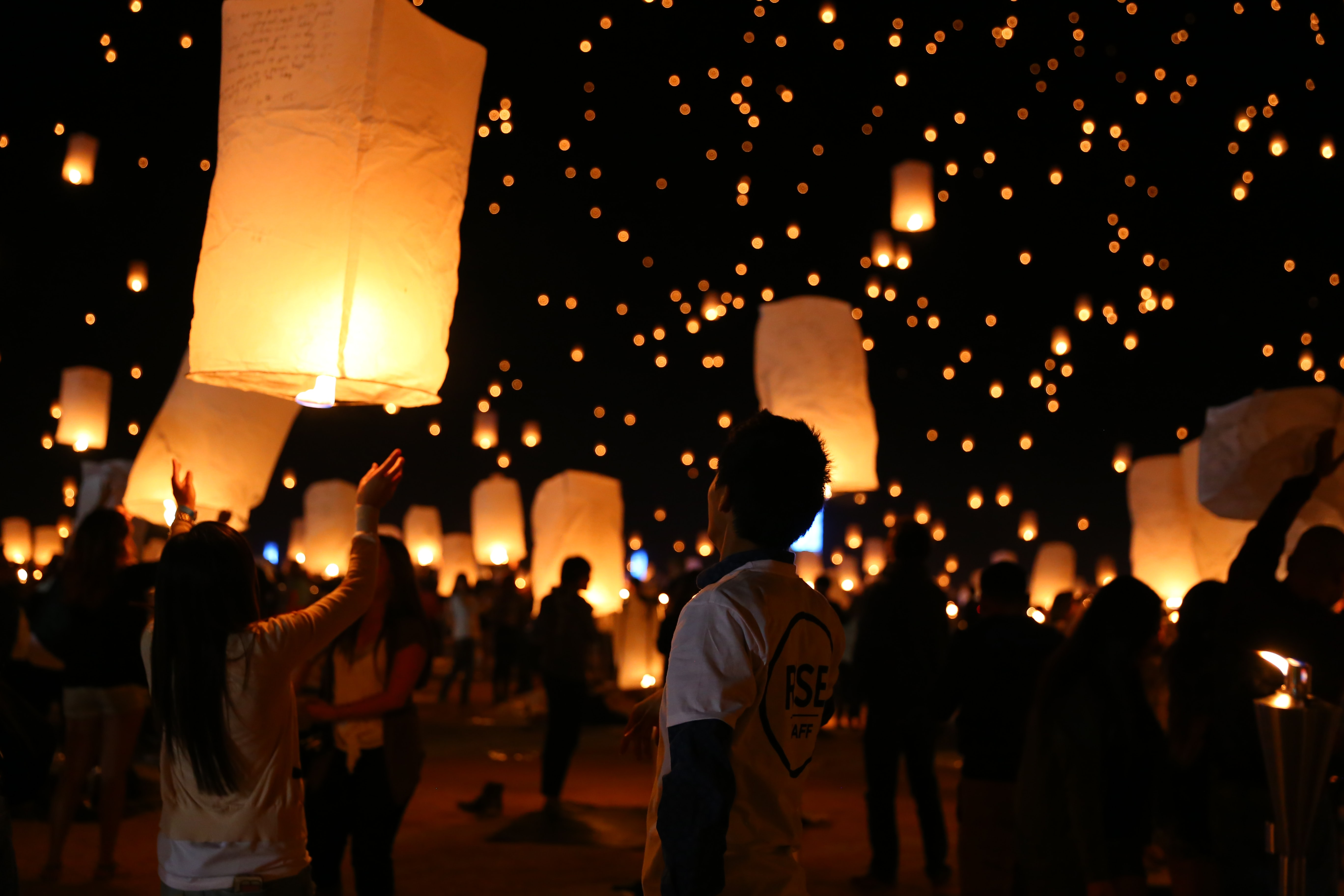 group of people gathering for a paper lantern festival