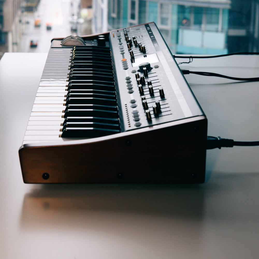 black and white electronic keyboard on table