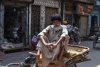 man sitting on trike