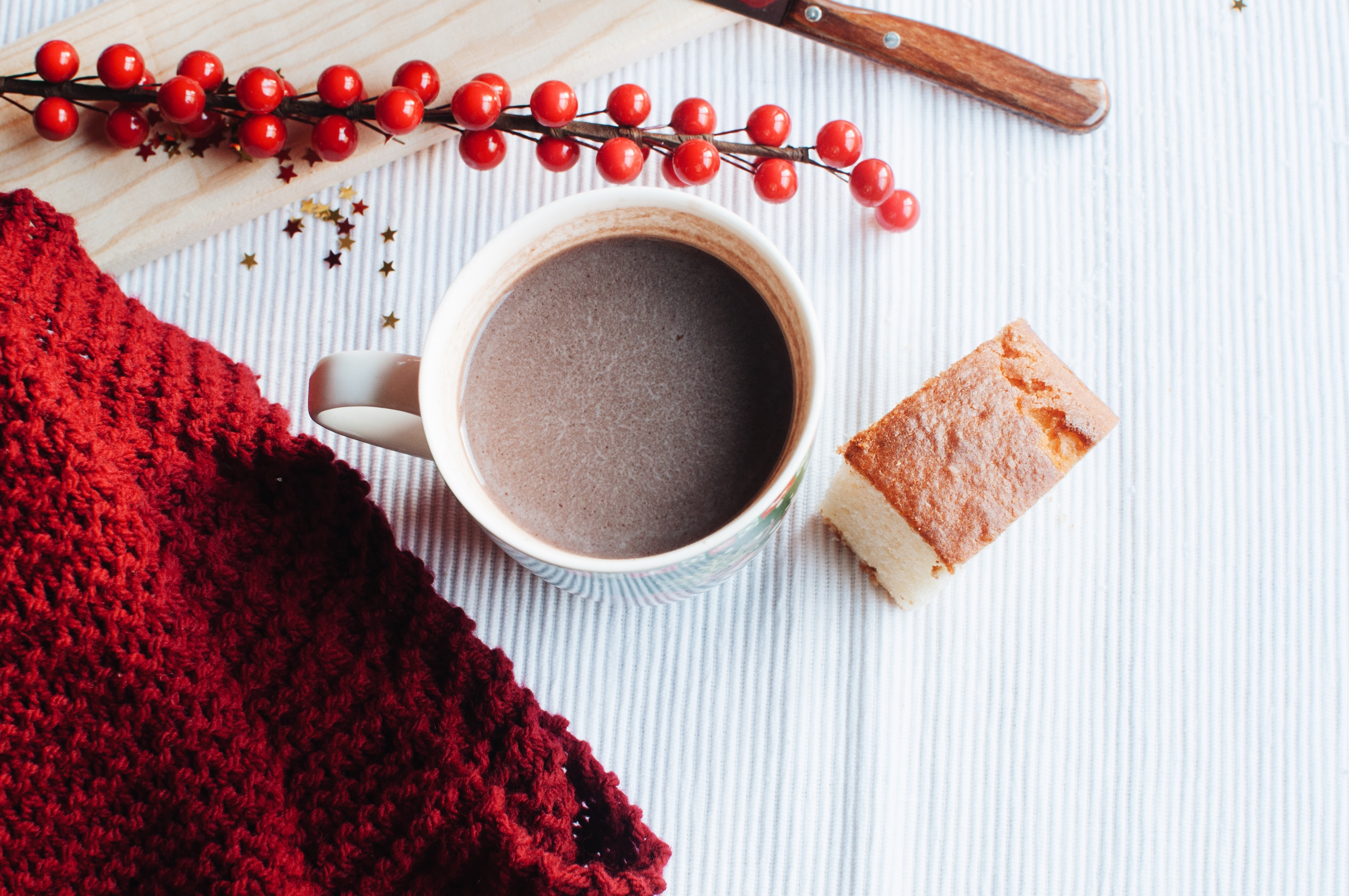 flat lay photo of a cup of coffee and slice cake