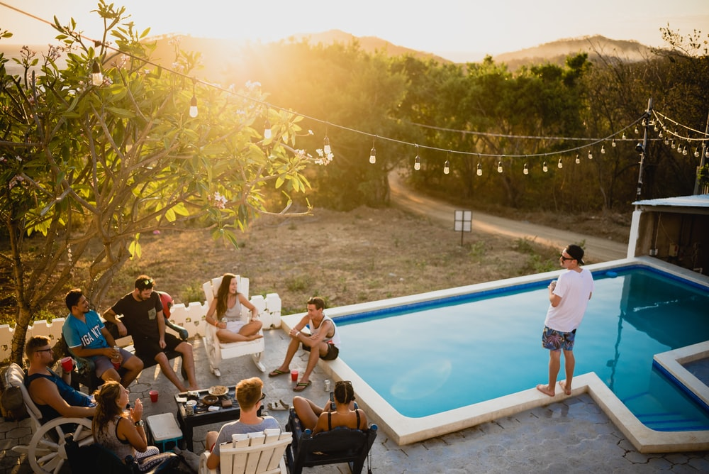 people sitting on chairs near pool