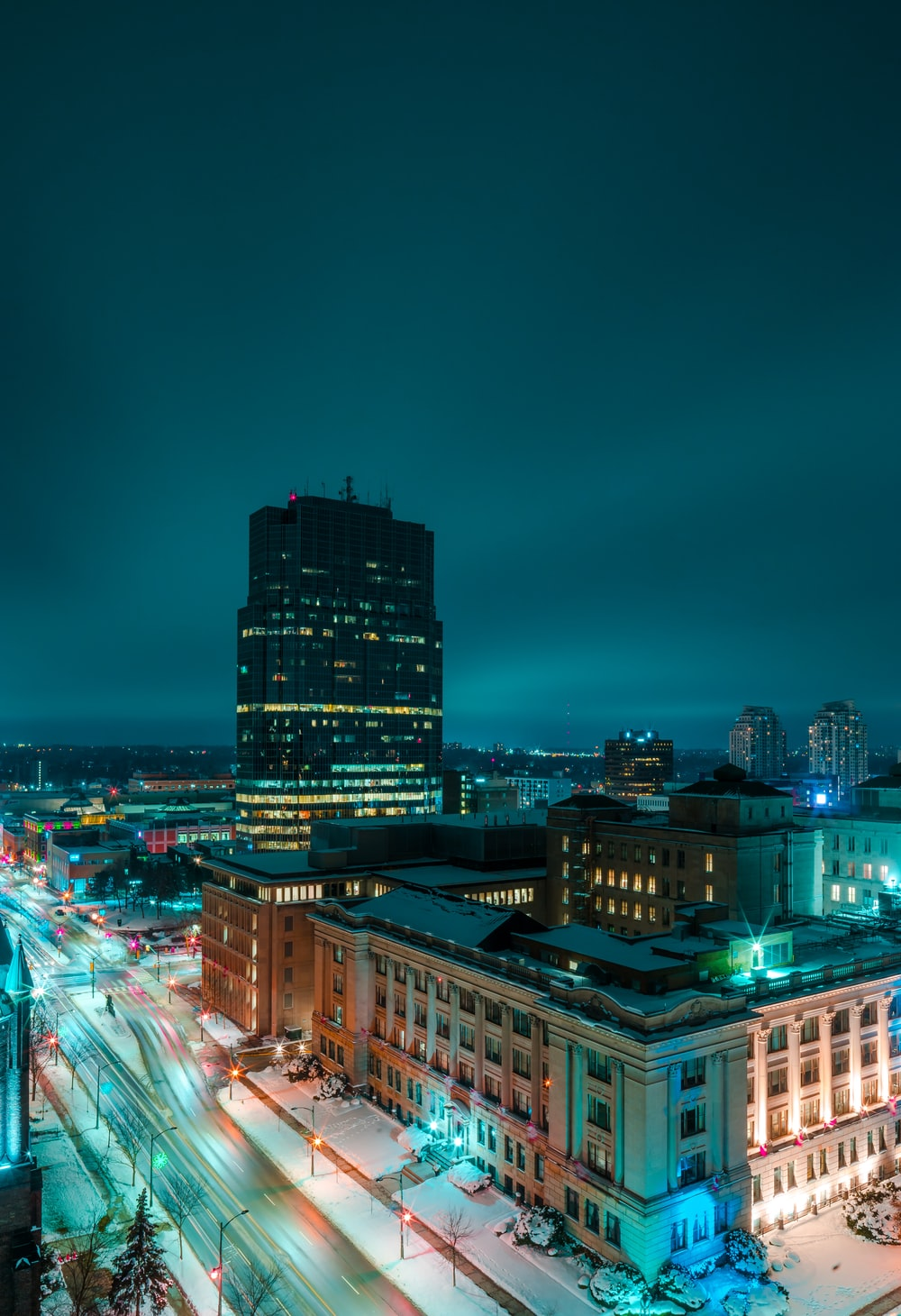 aerial photography of lighted city buildings at night