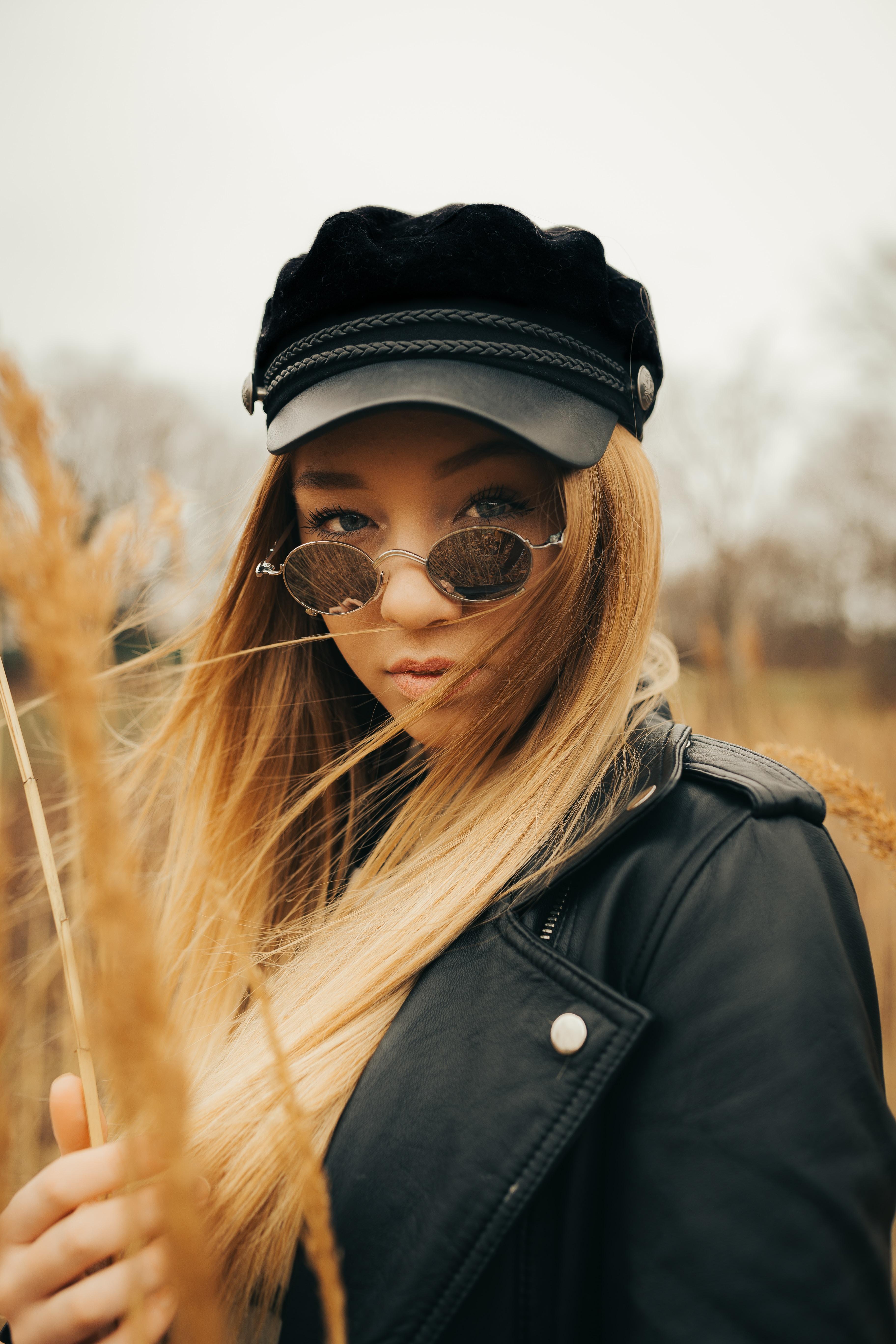 woman wearing sunglasses and holding stick