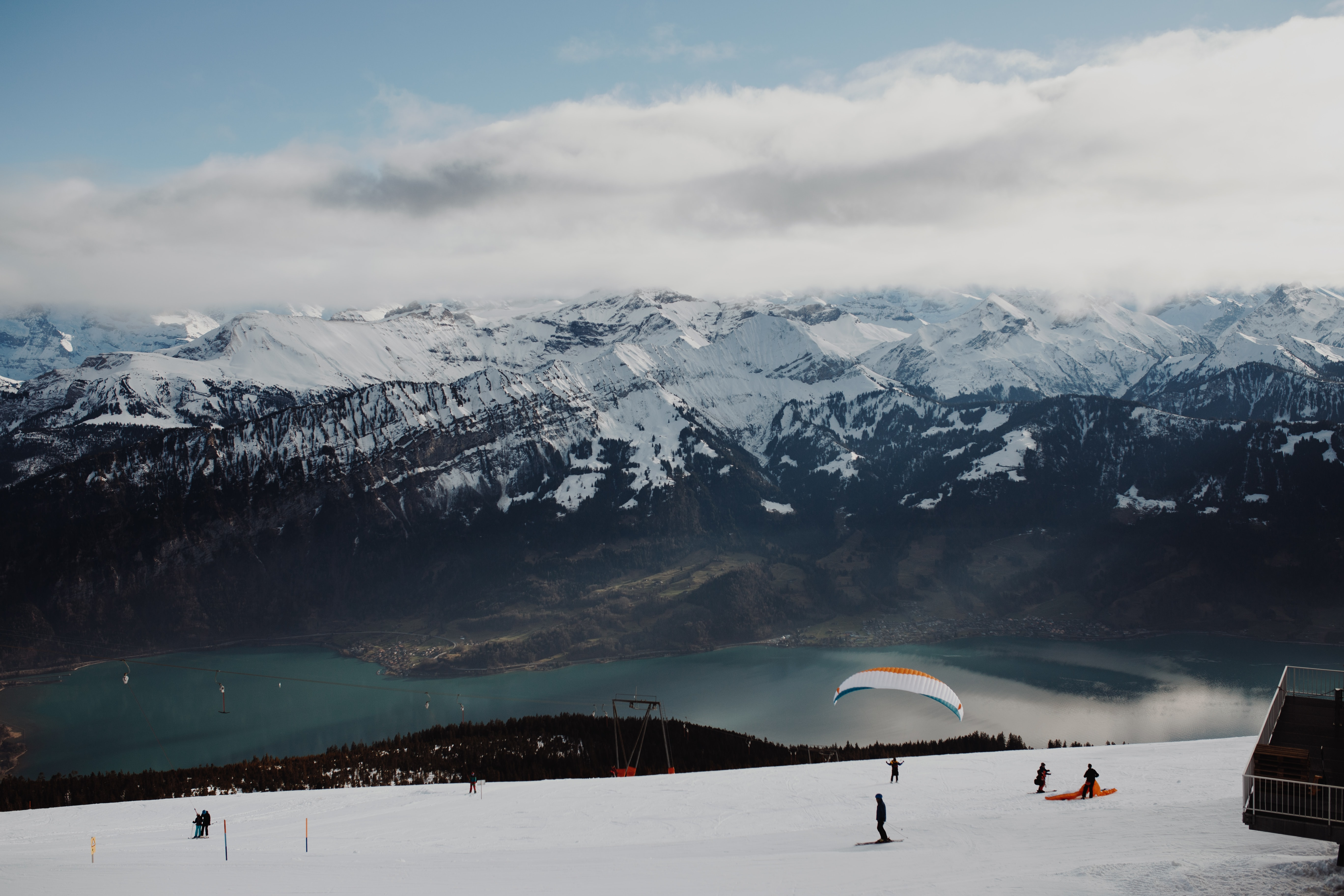 people skiing on snowy mountain slope