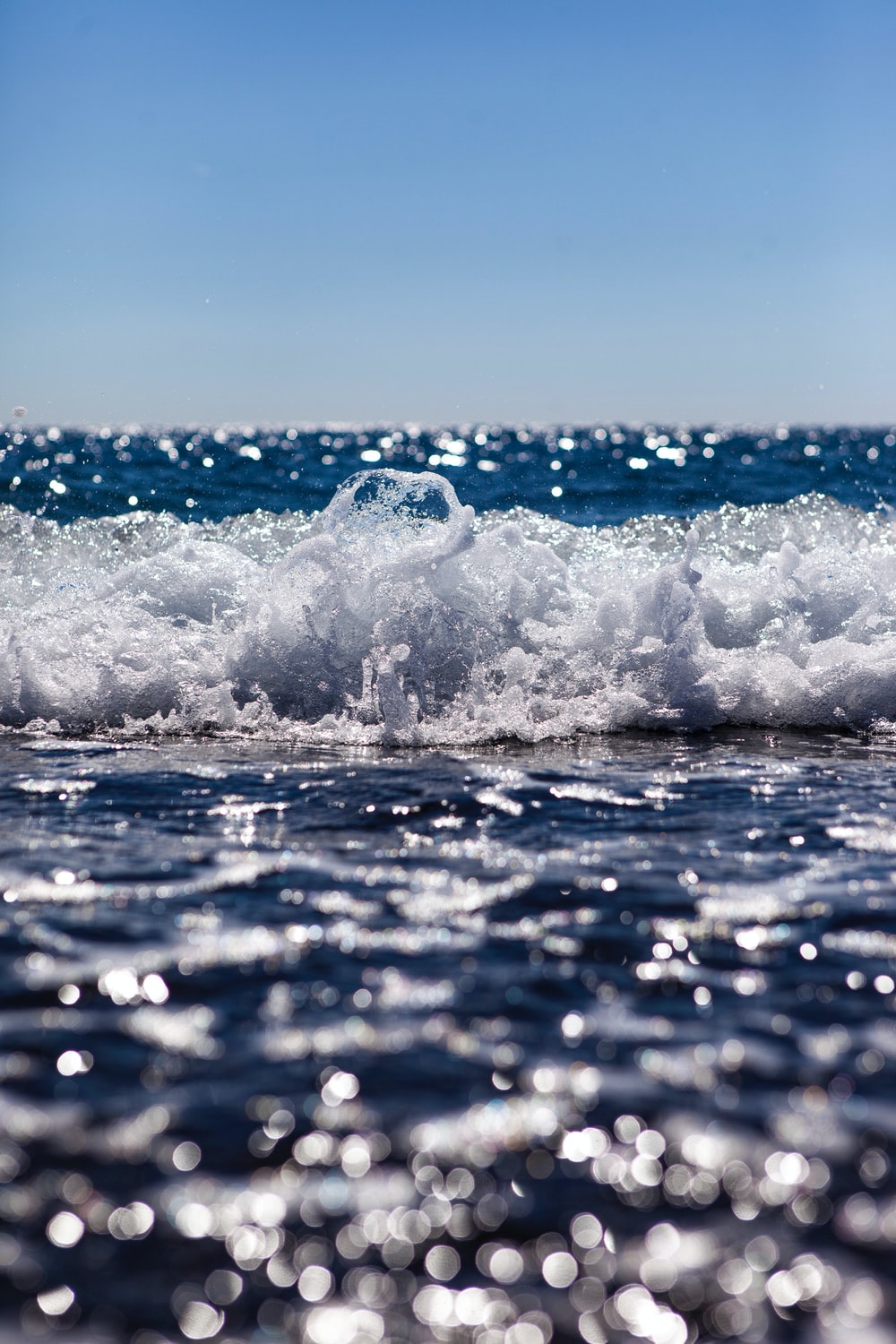 close up photography of ocean wave at daytime
