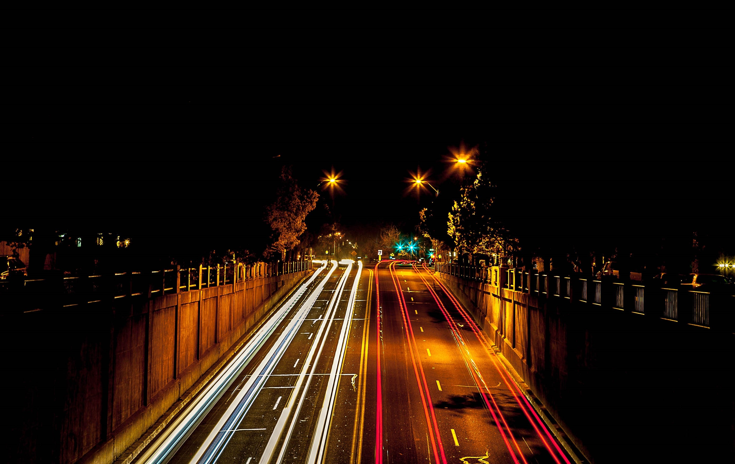 timelapse photography of cars passing through north and south