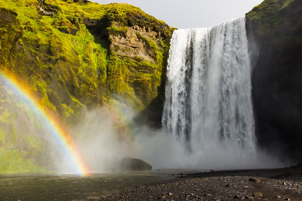 landscape photography of waterfalls and rainbow