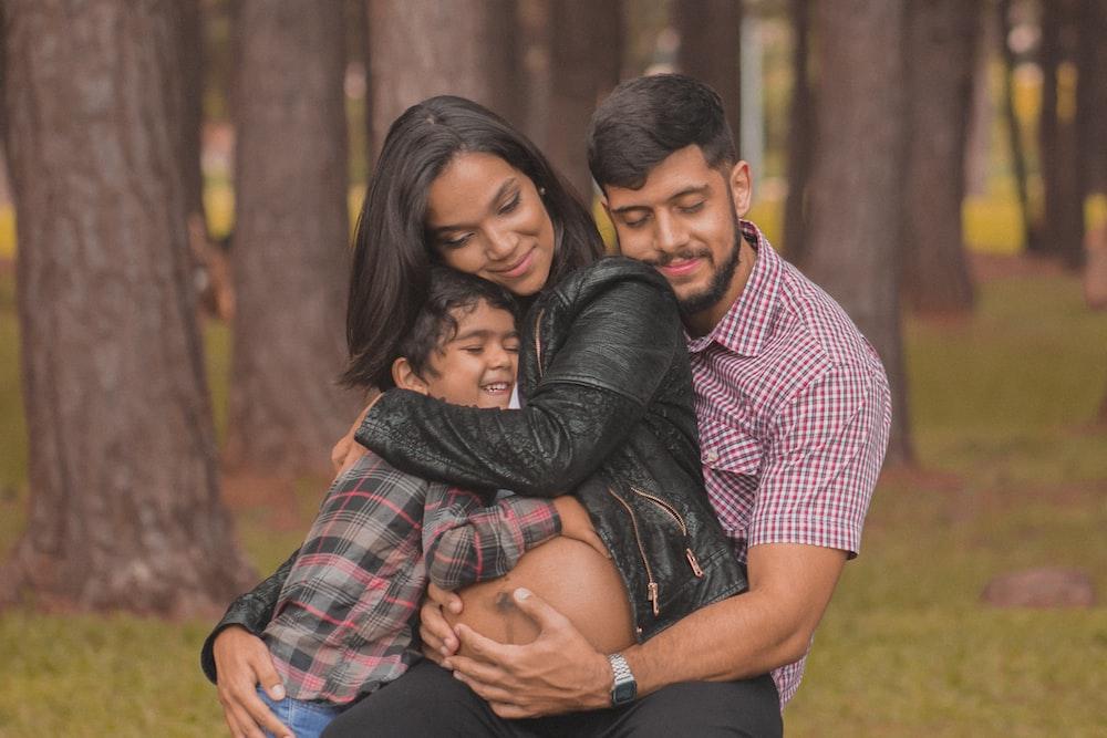 man hugging a woman