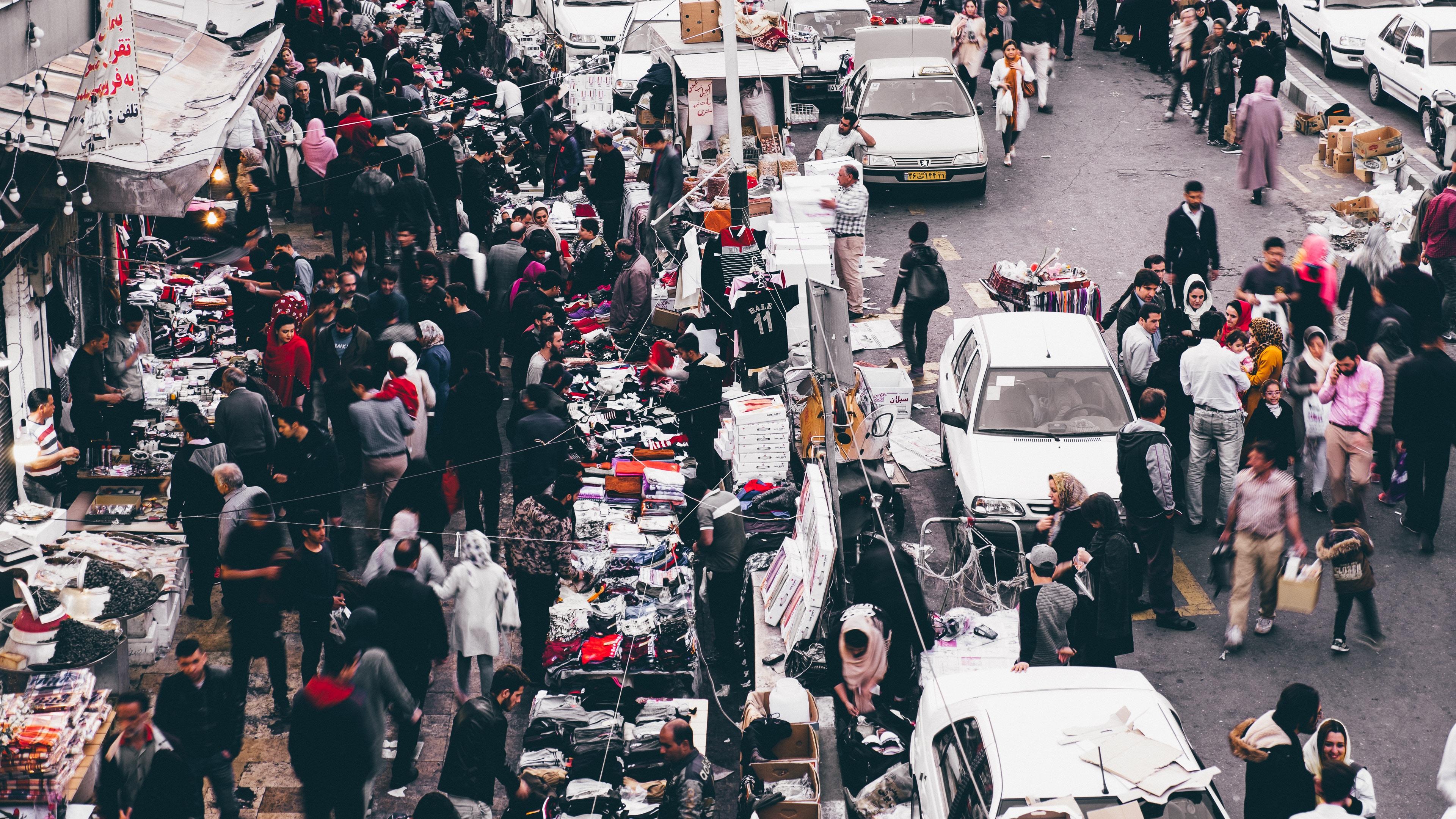 people gathering on road during daytime